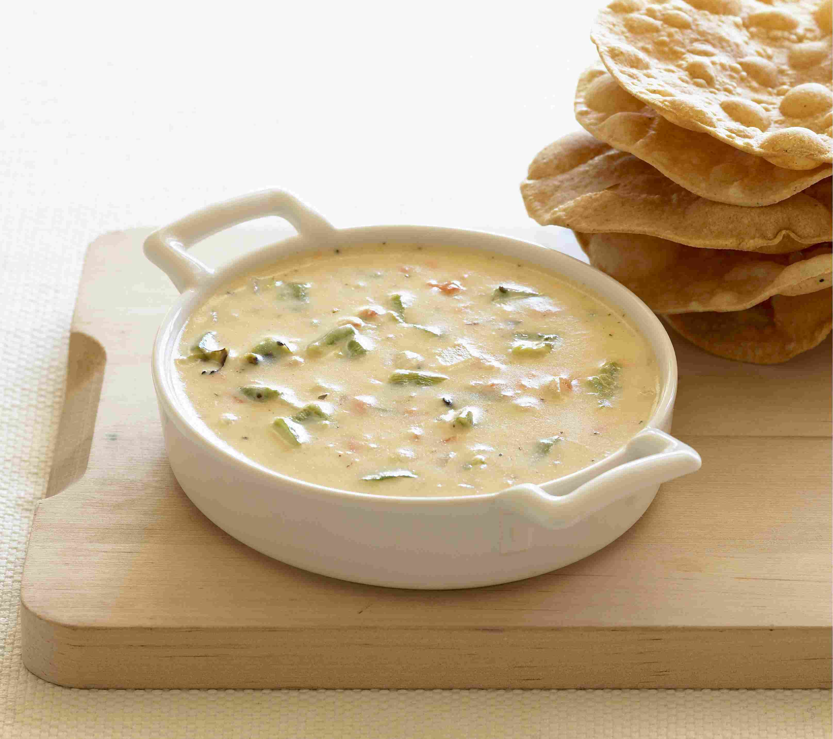 Mexican cheese and chilies dip and fried tortillas