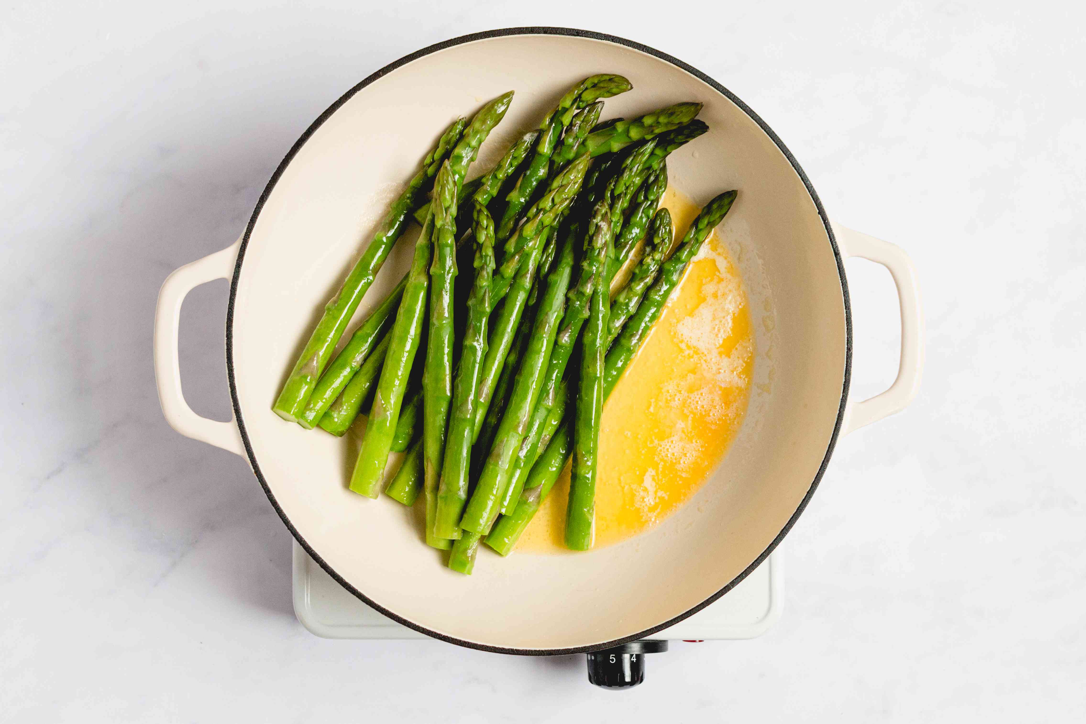 butter and asparagus in a saucepan