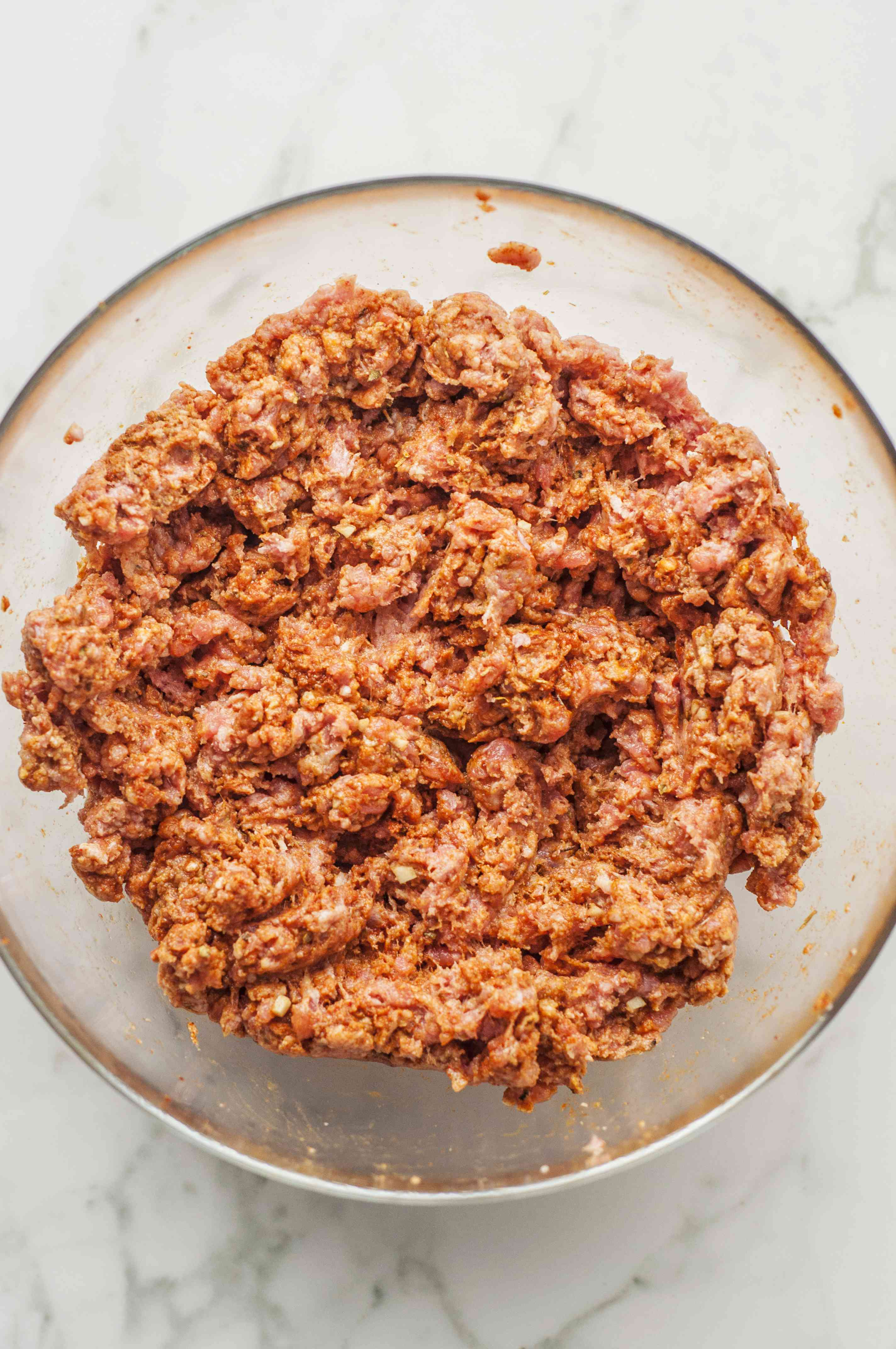 Ground pork is mixed with vinegar and seasonings