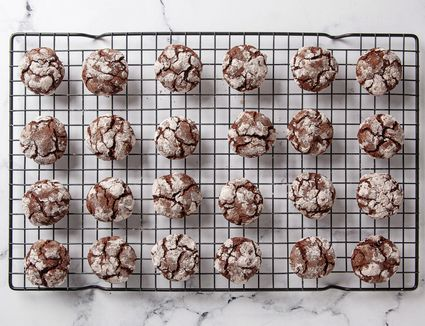 chocolate crinkle cookies on baking rack