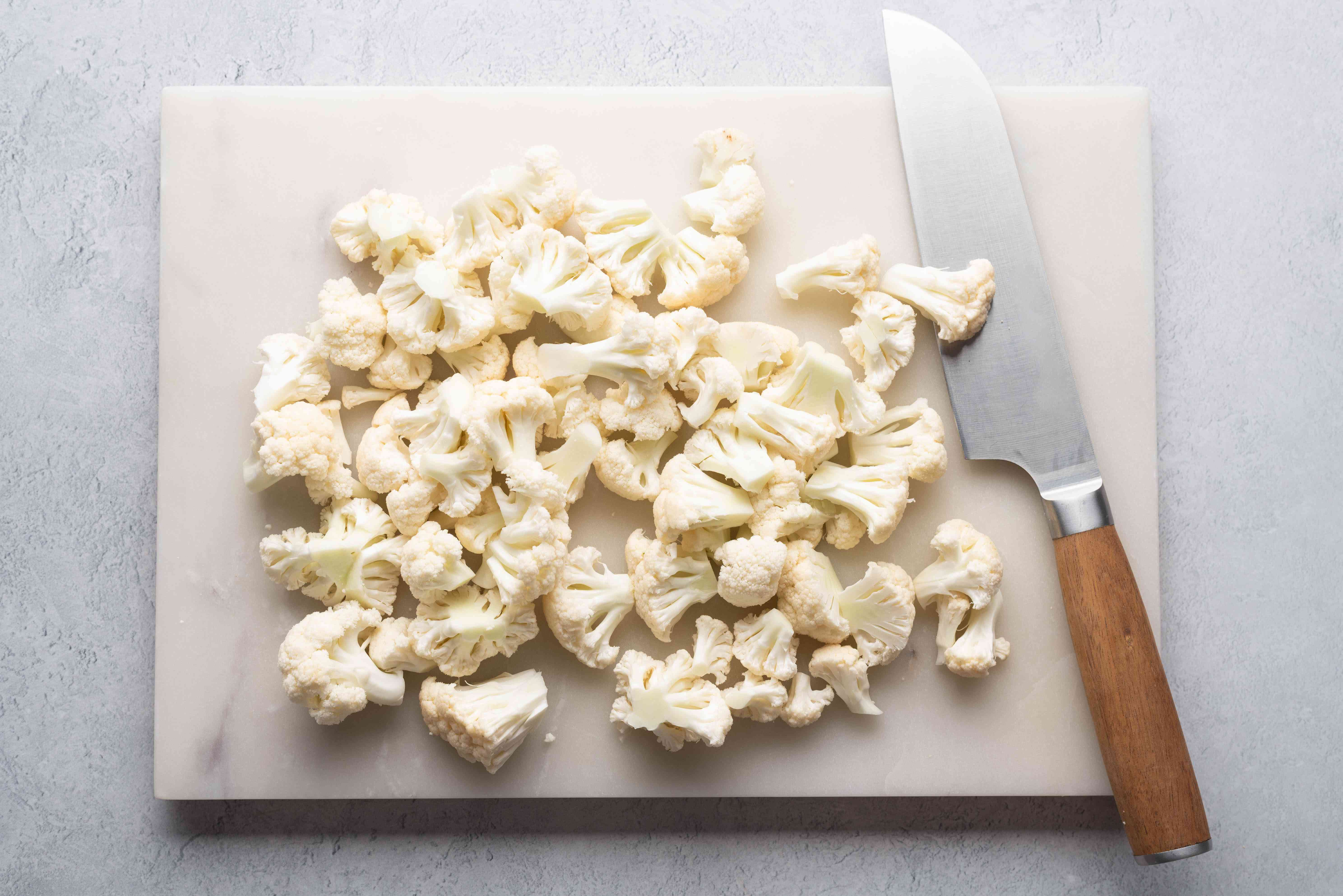 Clean and separate the cauliflower