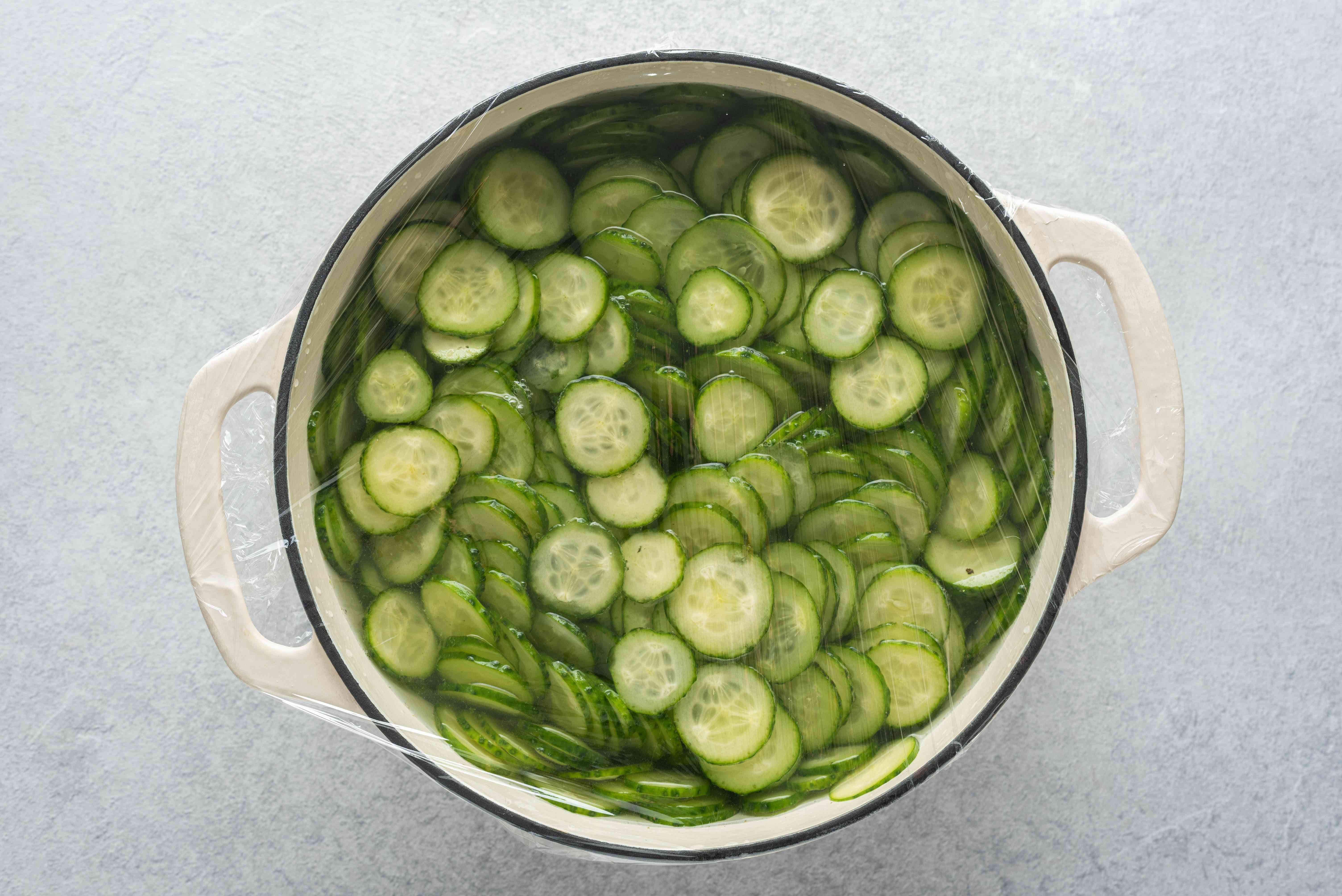 cucumber slices in a pot with salted water