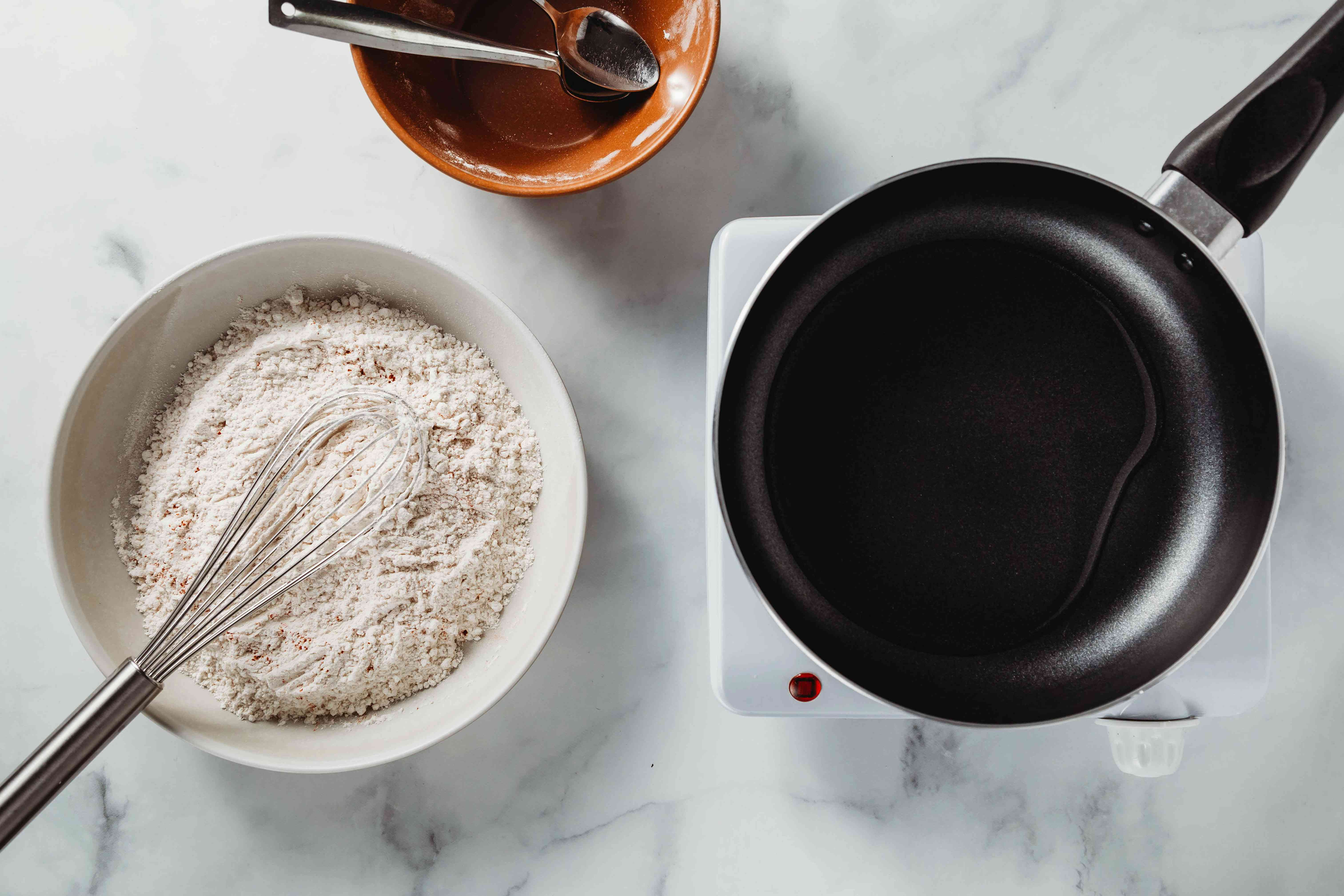in a shallow dish, mix flour, salt, and paprika together