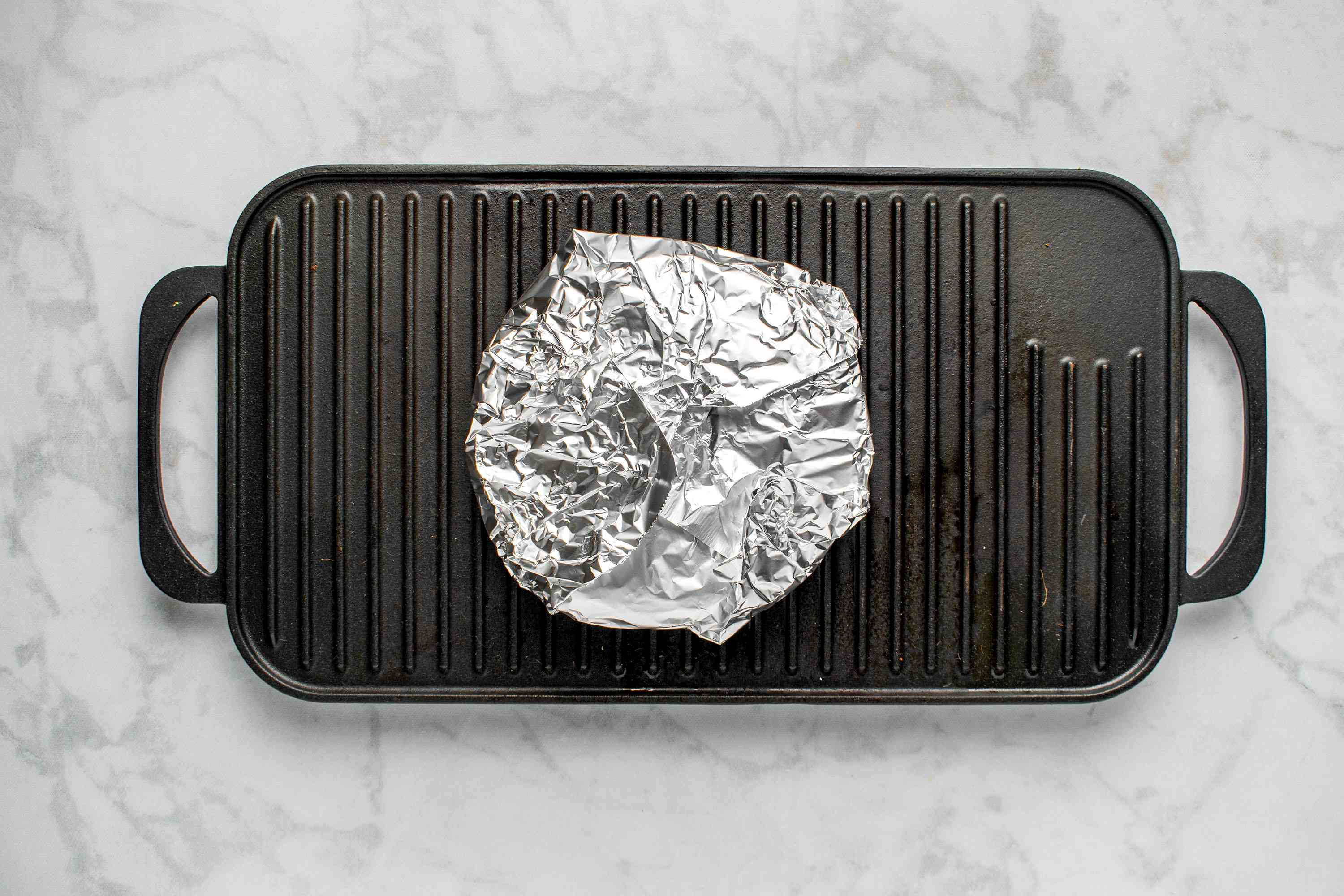 Wrap tortillas in foil and place on top of the grill