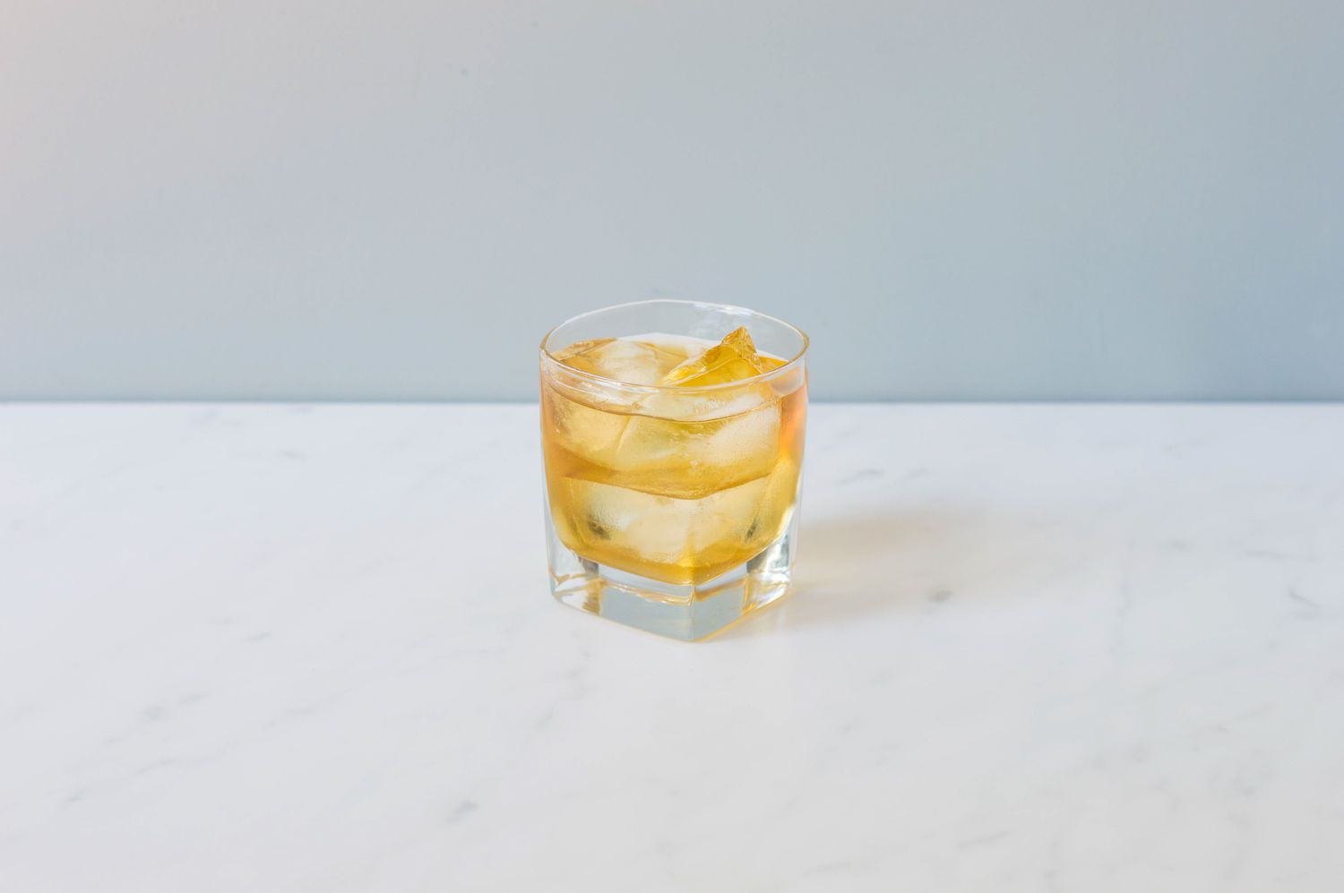 Rusty nail cocktail in an old-fashioned glass with ice