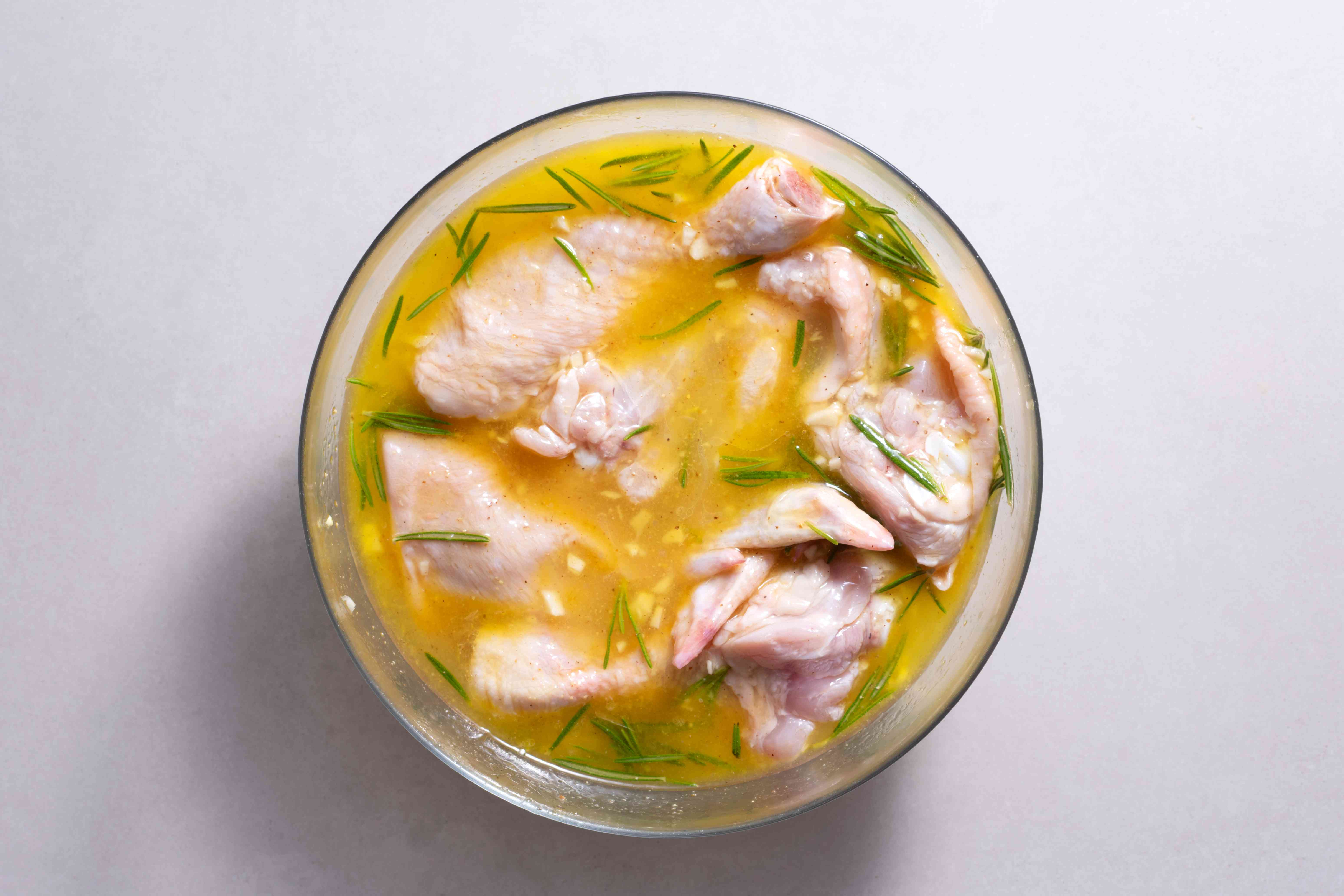 Lemon and Rosemary Marinade Recipe with Chicken in a bowl