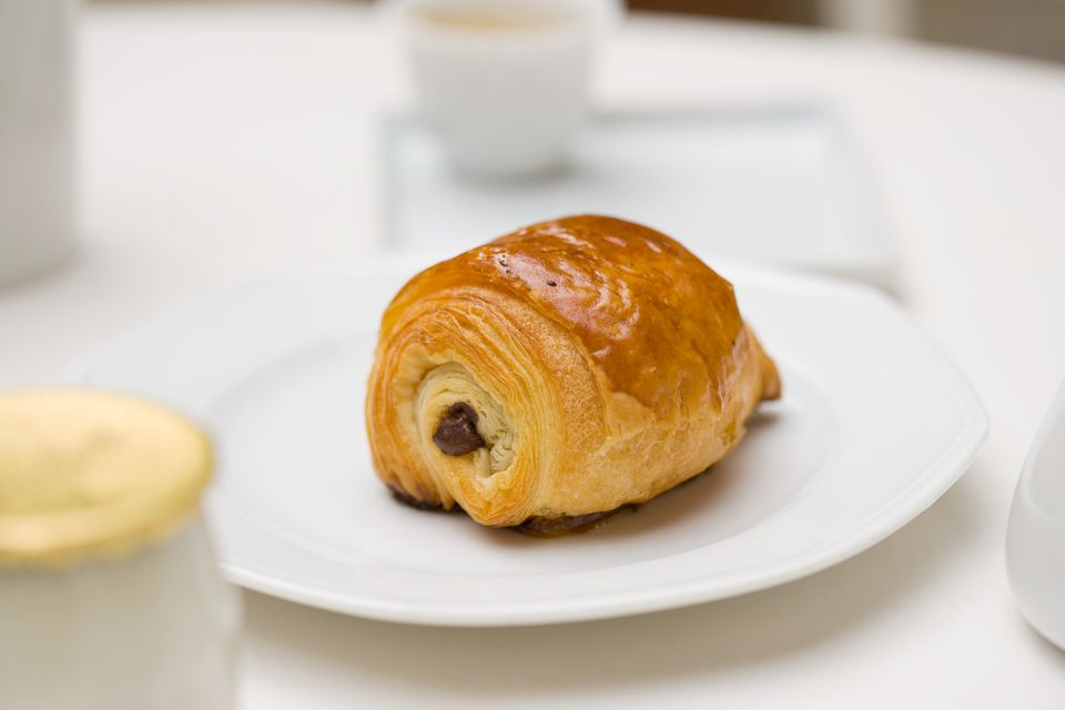 Pain au chocolat on a plate.