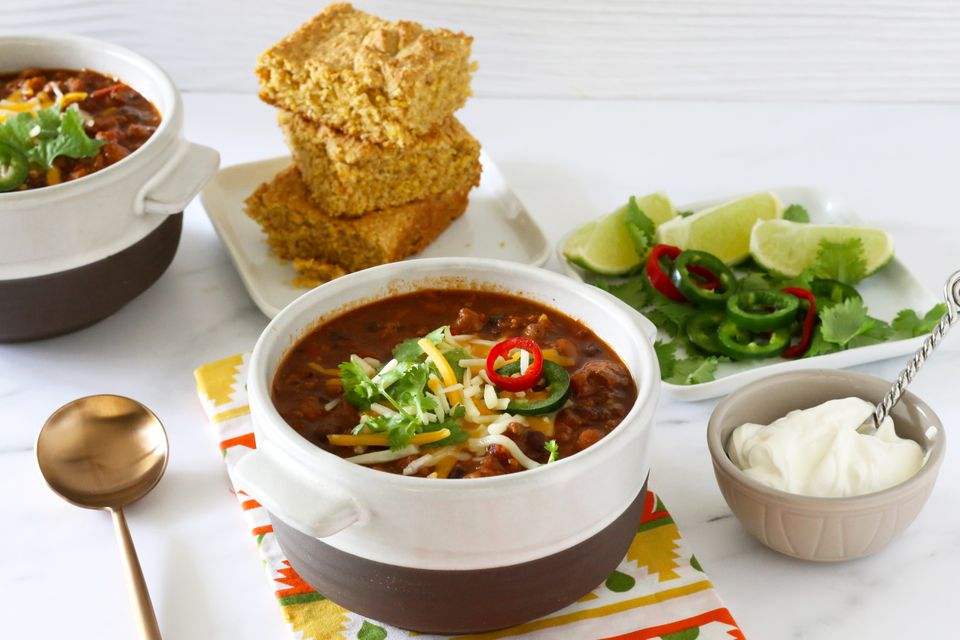 Serve the chili with cornbread and toppings.