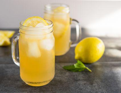 Lynchburg lemonade in Mason jars on a dark tabletop