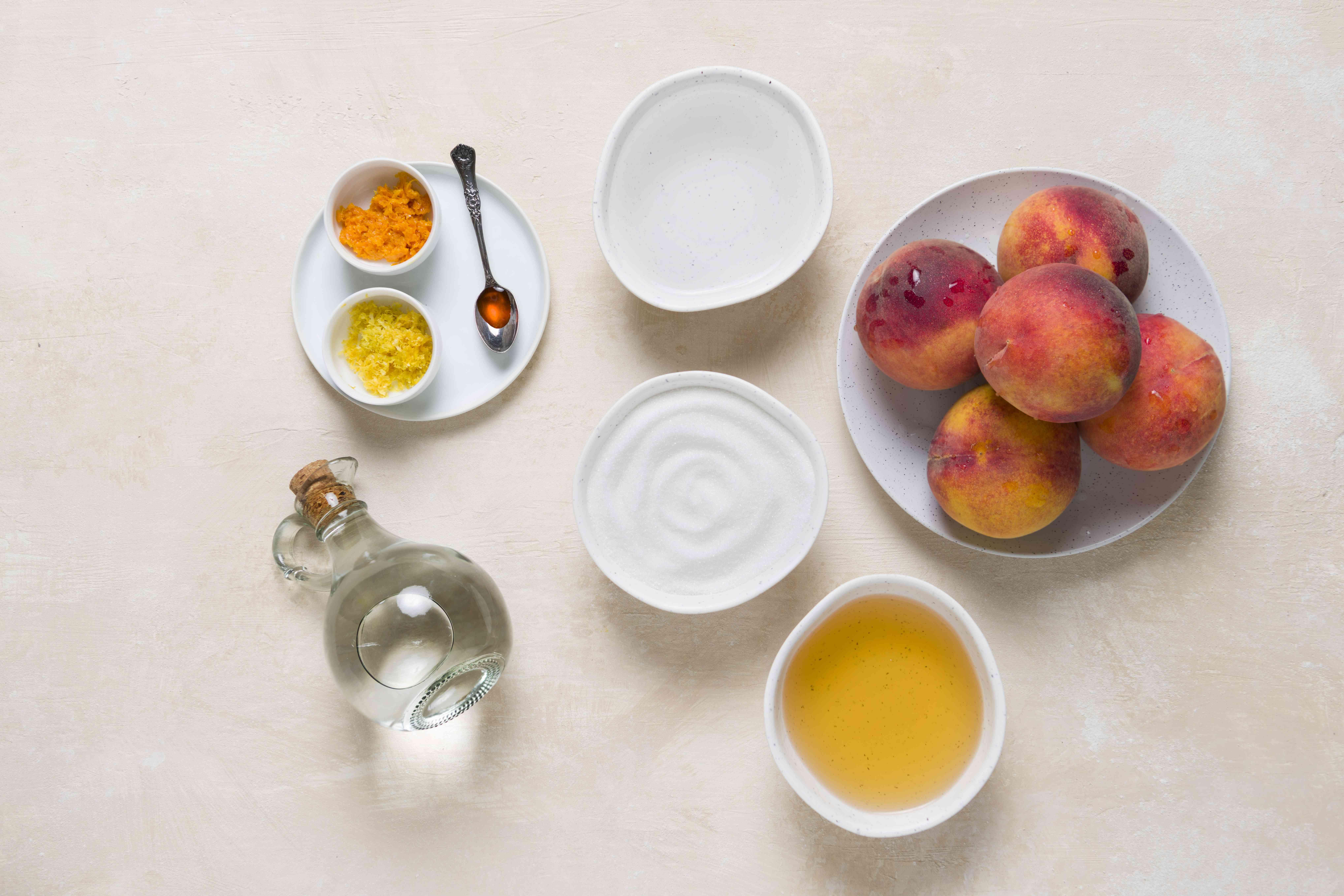 Ingredients to make peach liqueur
