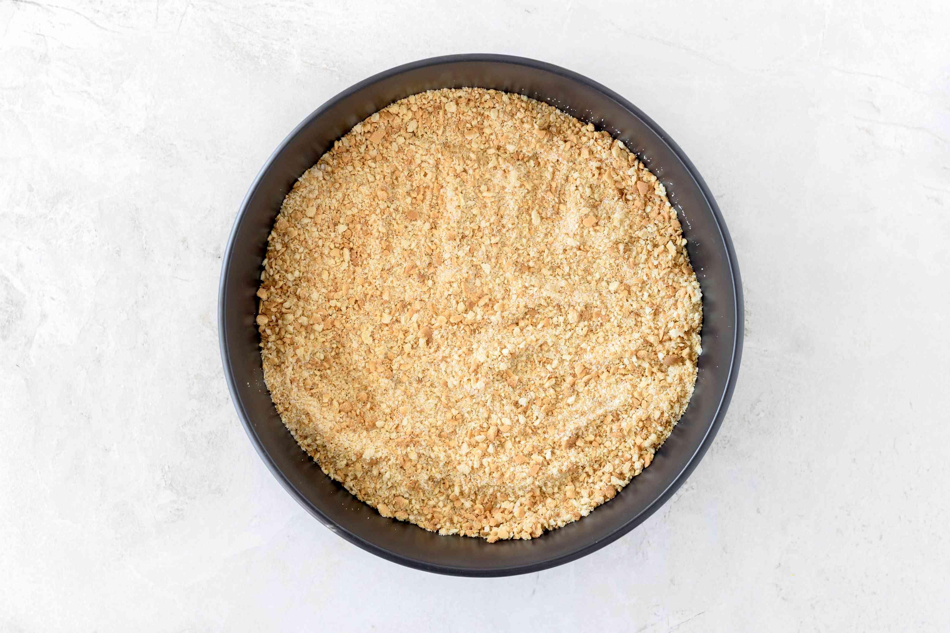 Graham cracker crumbs and sugar in bowl
