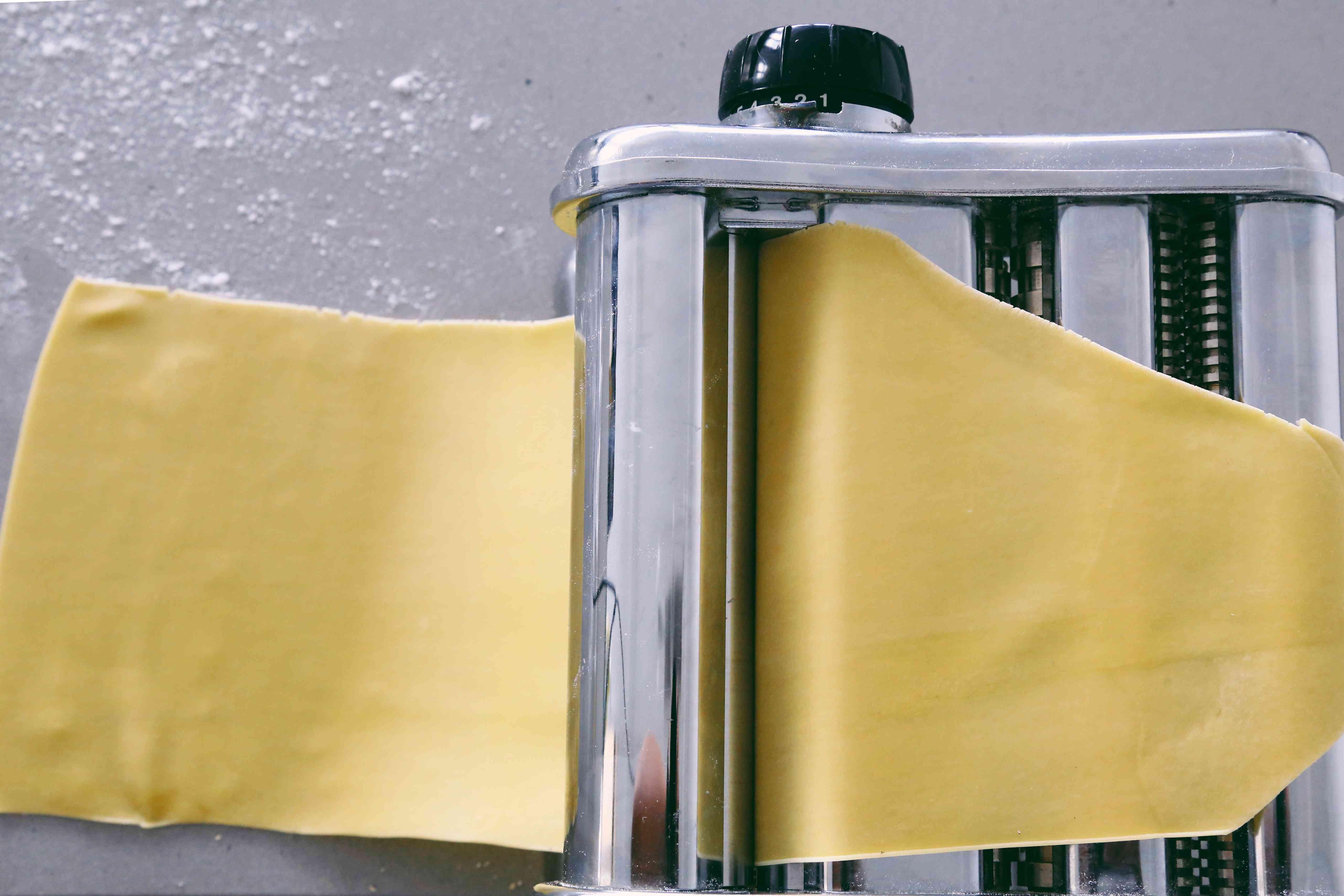pasta dough sheet in a pasta roller