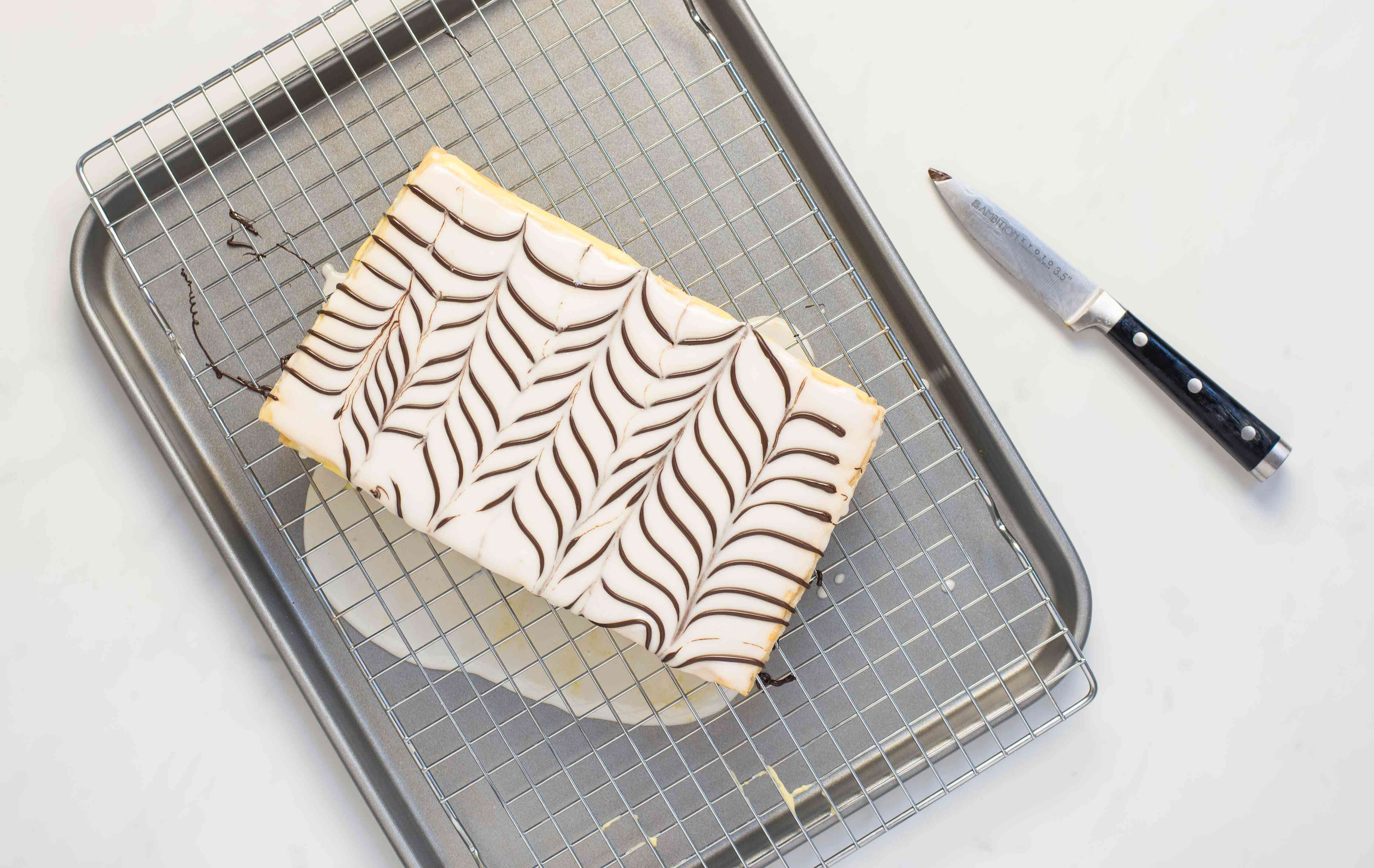 Chocolate icing decorated in a chevron pattern