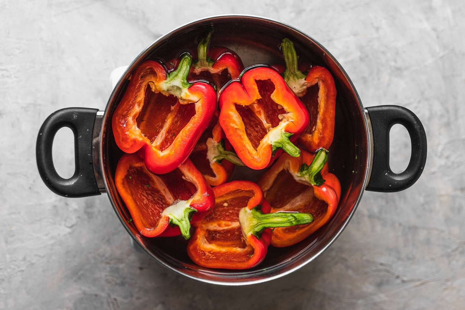 red bell peppers in a pot of salted water