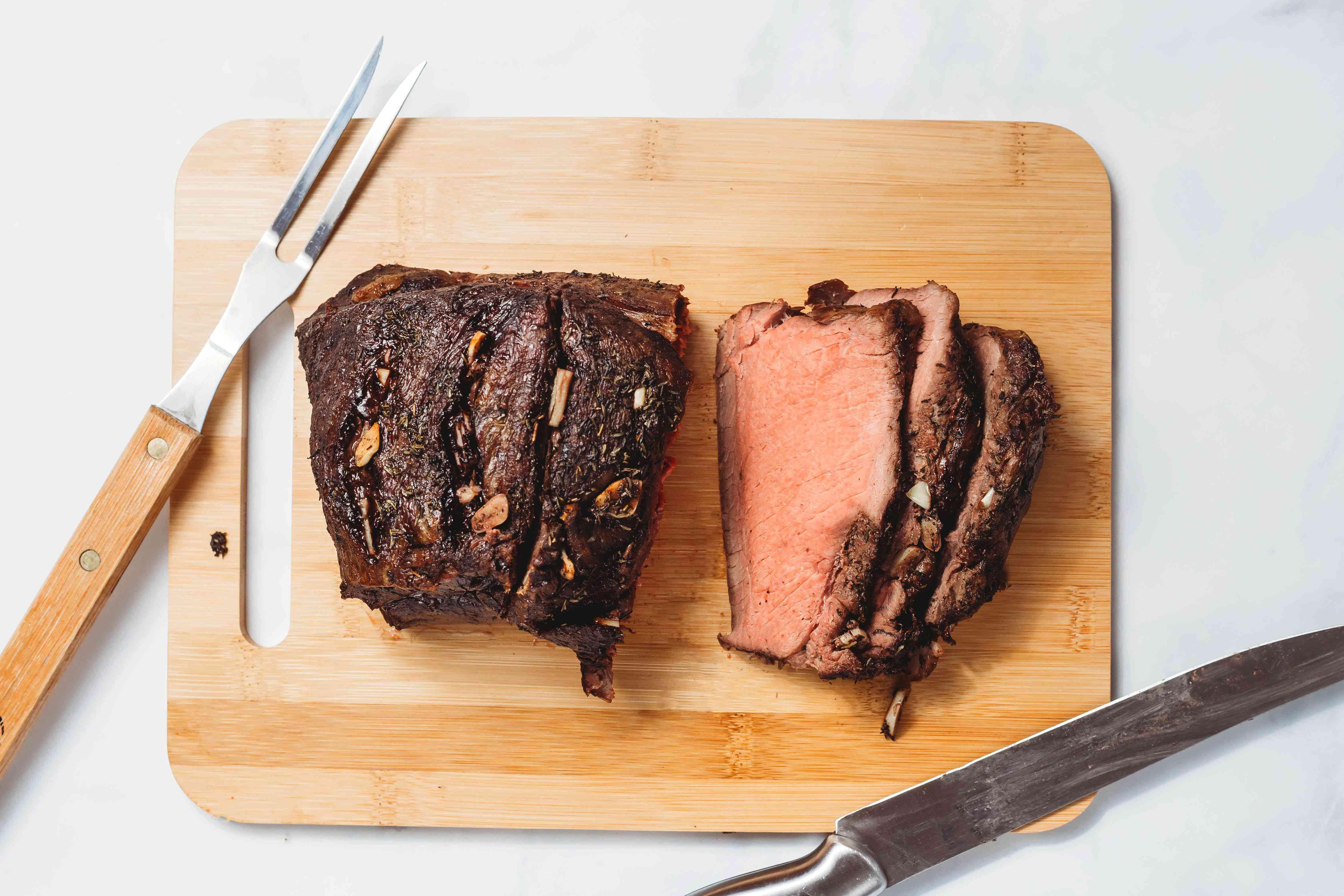 Boneless Top Sirloin Roast sliced on a cutting board