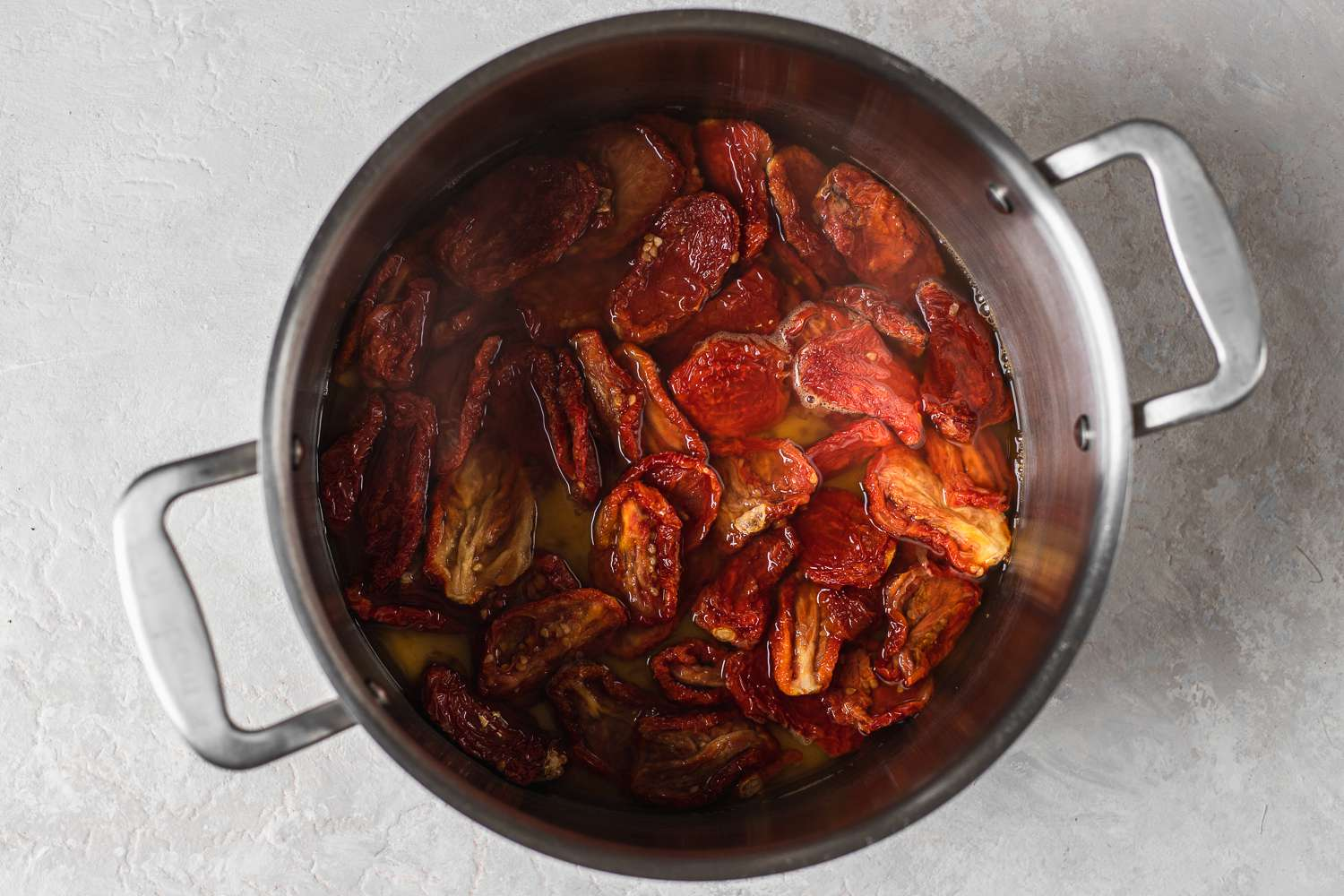 sun-dried tomatoes cooking in the vinegar mixture