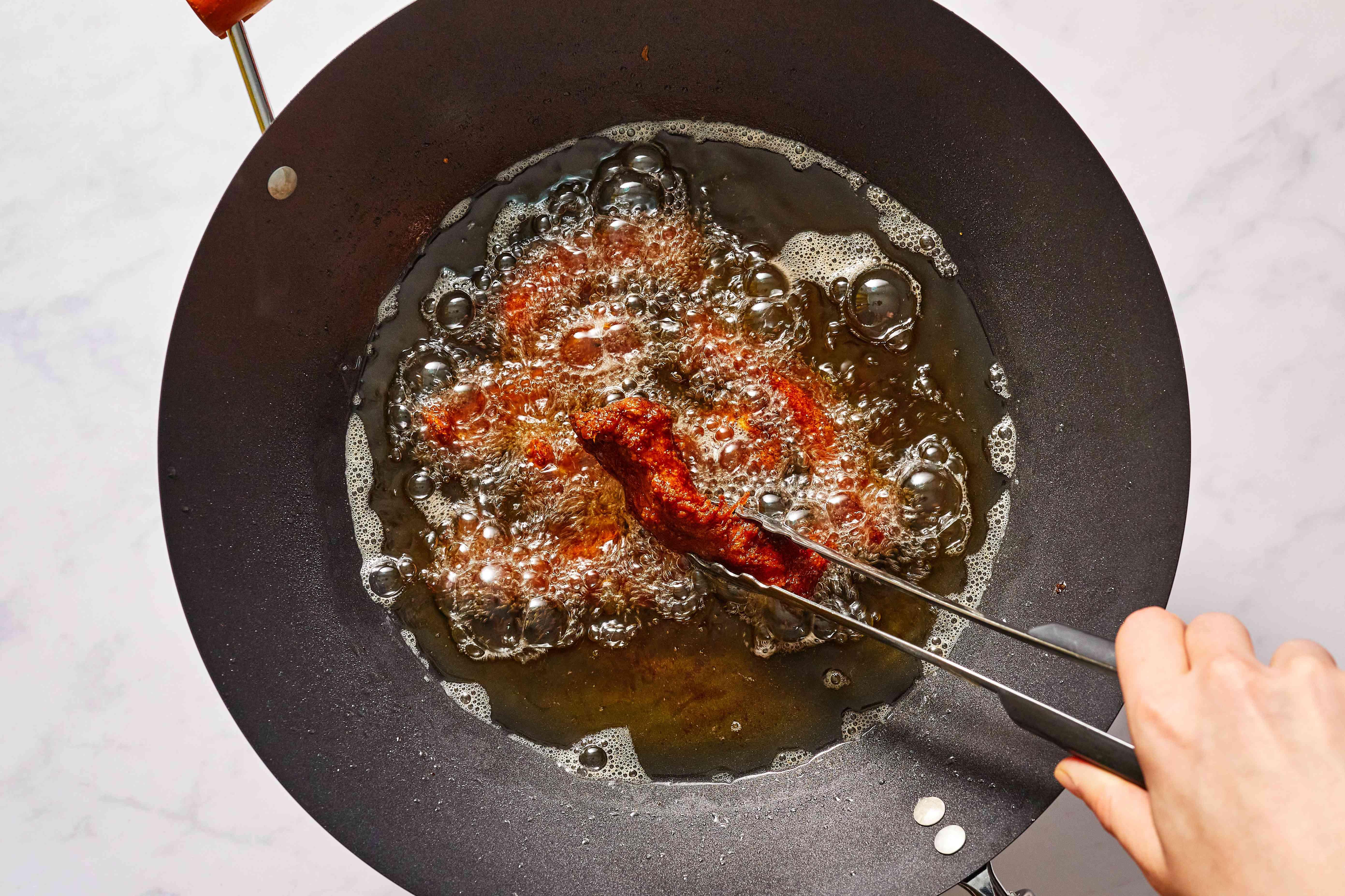 deep fry the spareribs in a pot