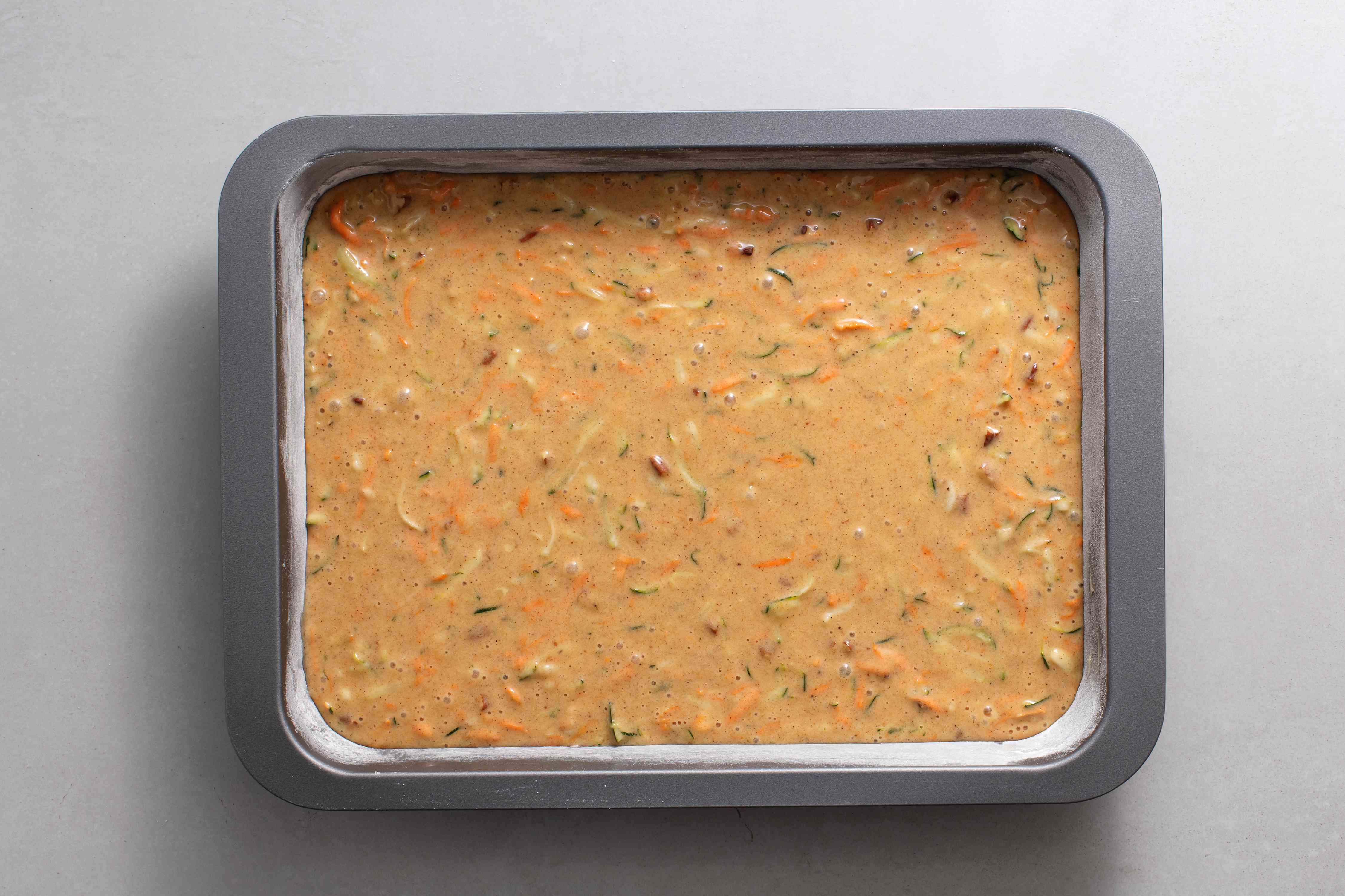 Spread the cake batter in the prepared baking pan