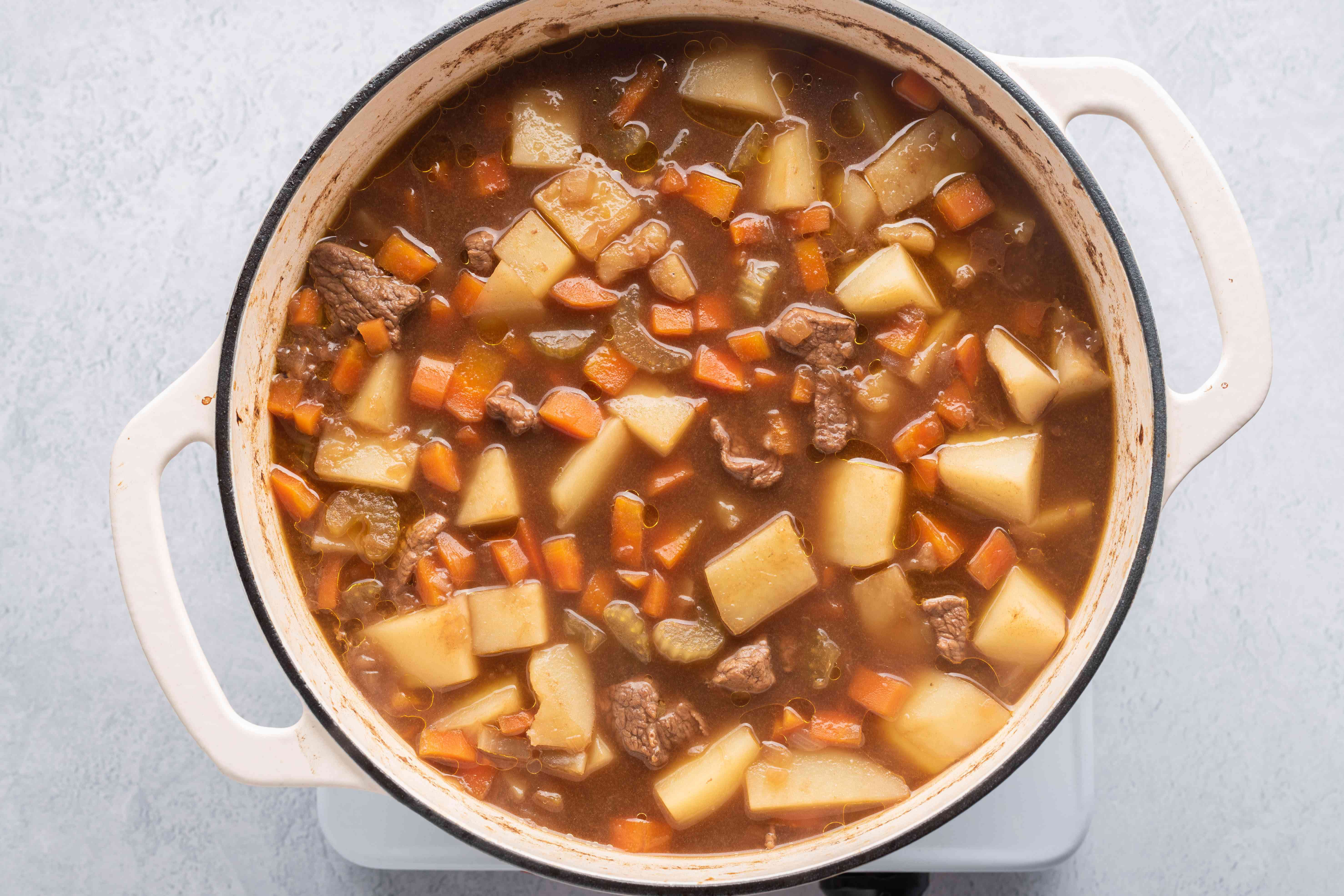 beef stew cooking in a Dutch oven