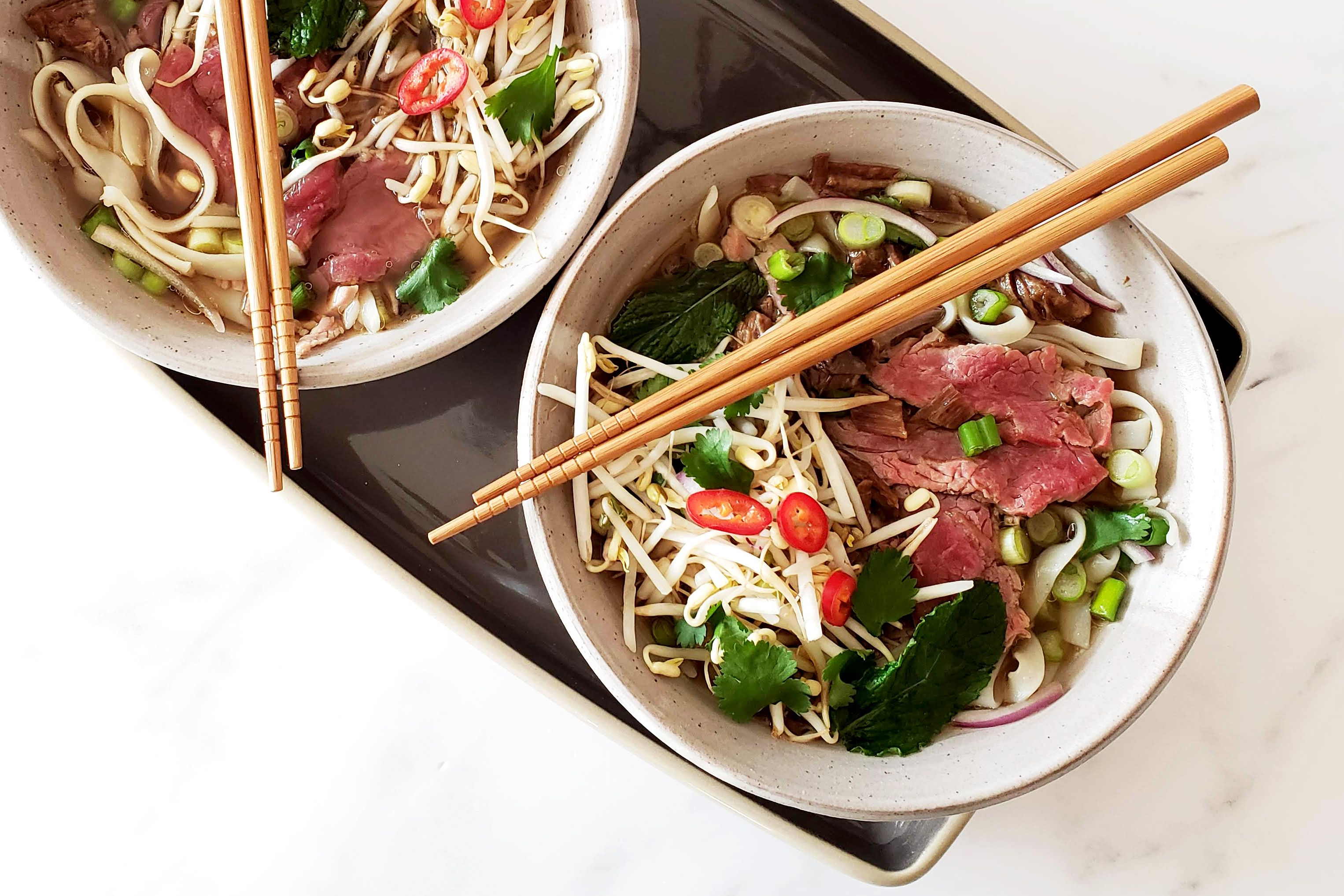 Instant Pot beef pho soup in bowls.
