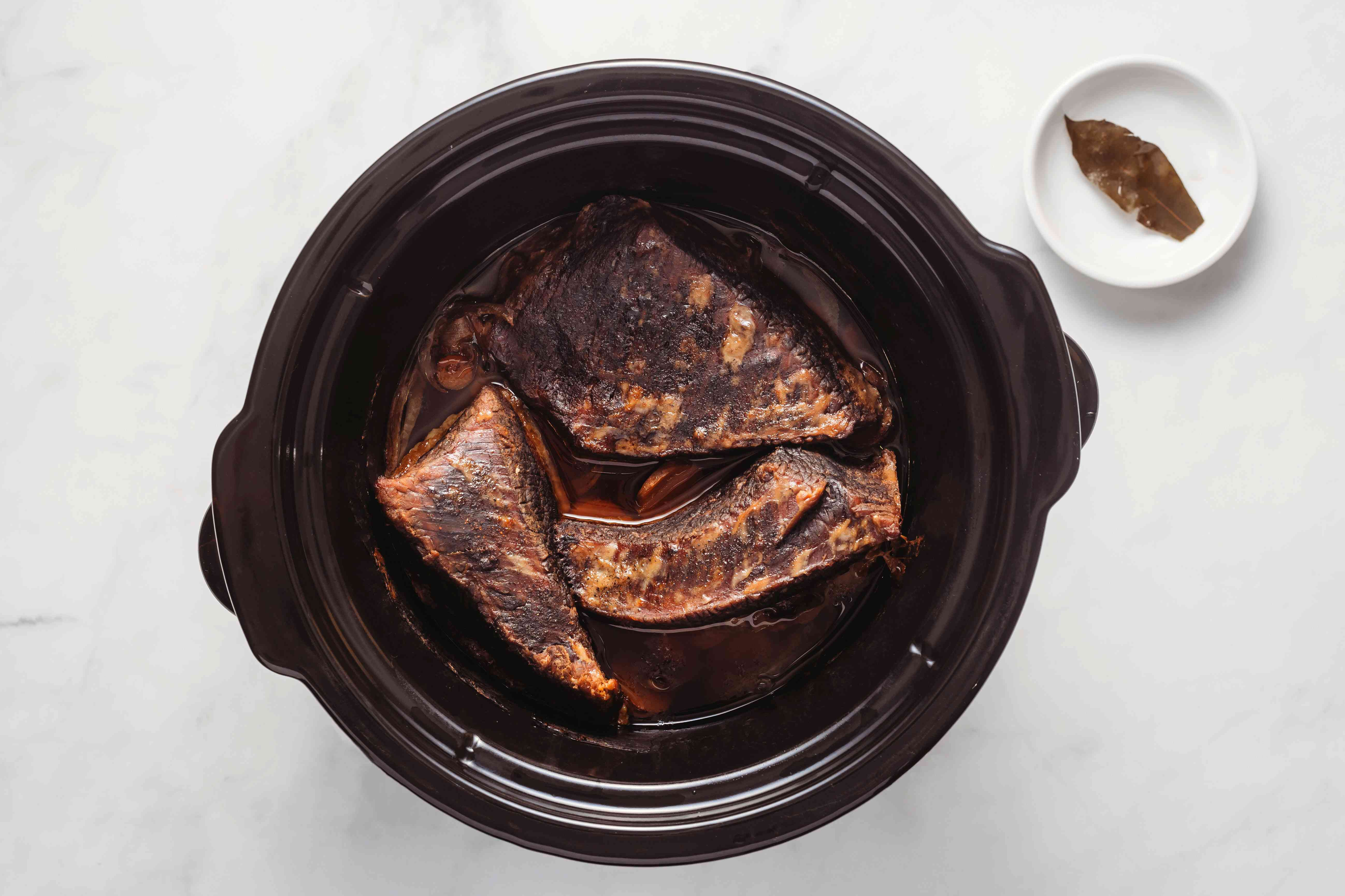 beef cooking in a slow cooker