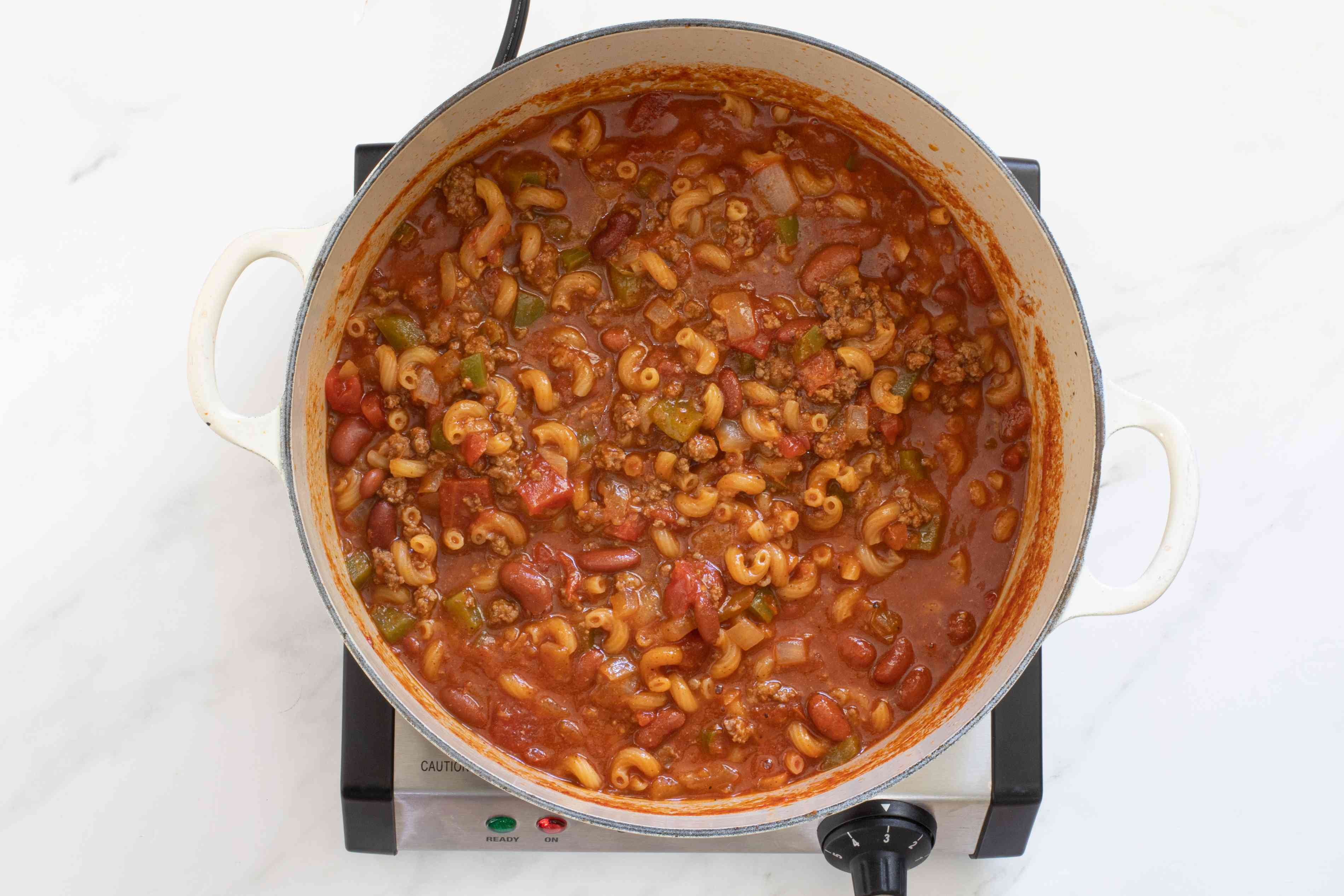 Add the macaroni and continue to cook