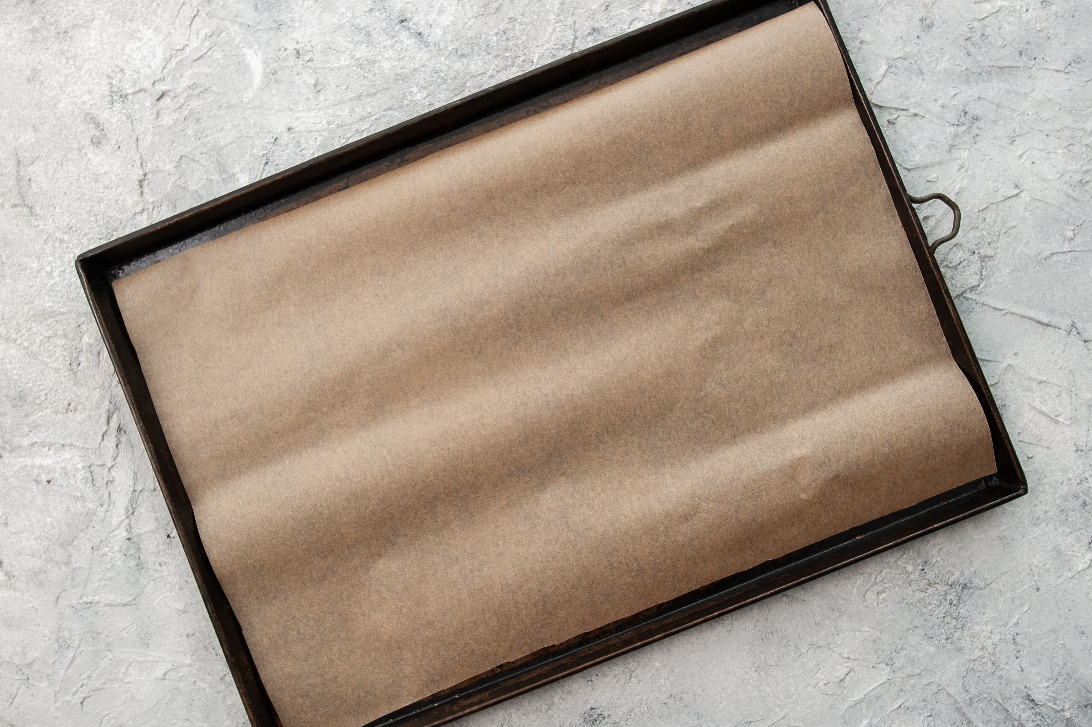 Grease cookie sheet
