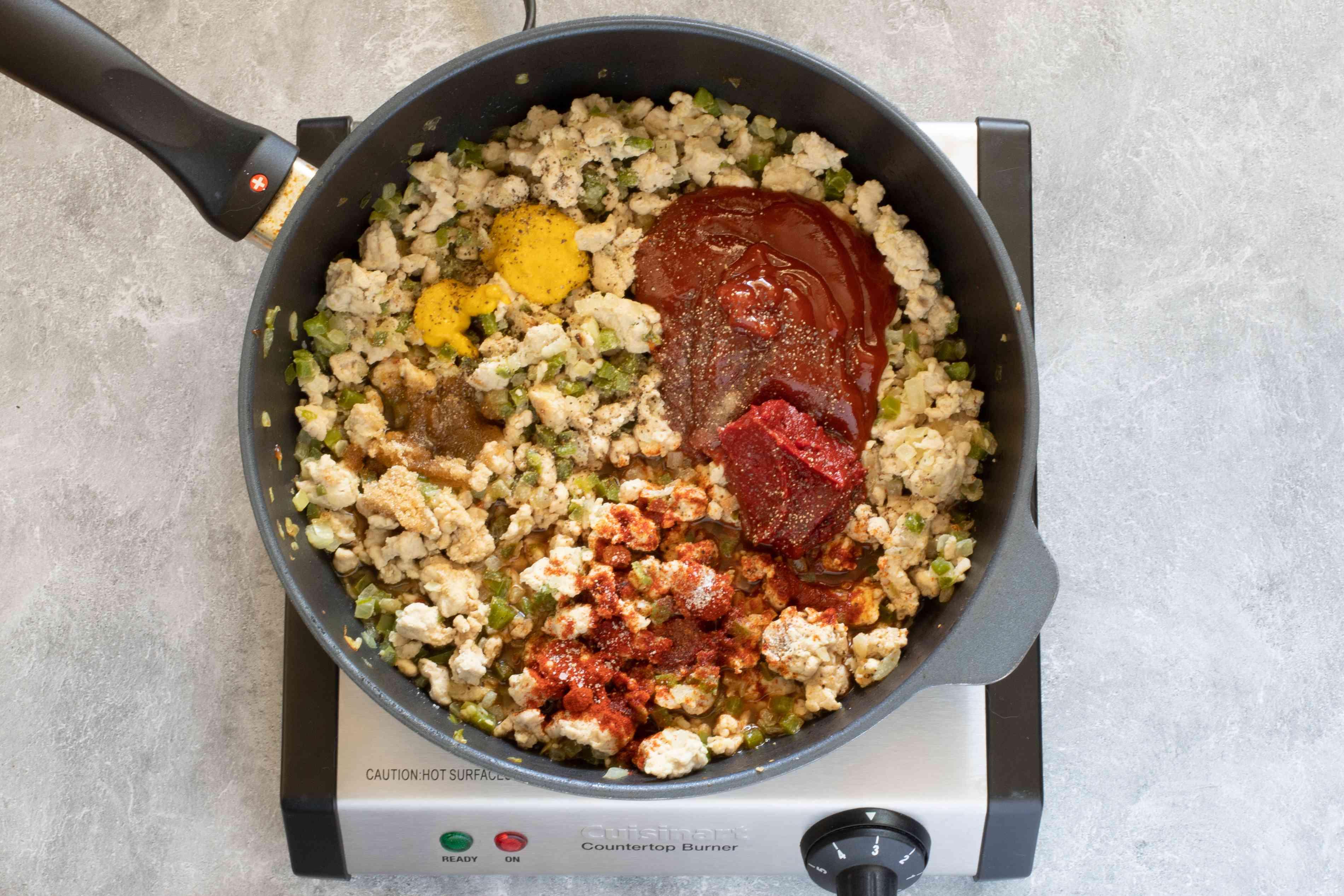 adding the sauce ingredients to ground turkey