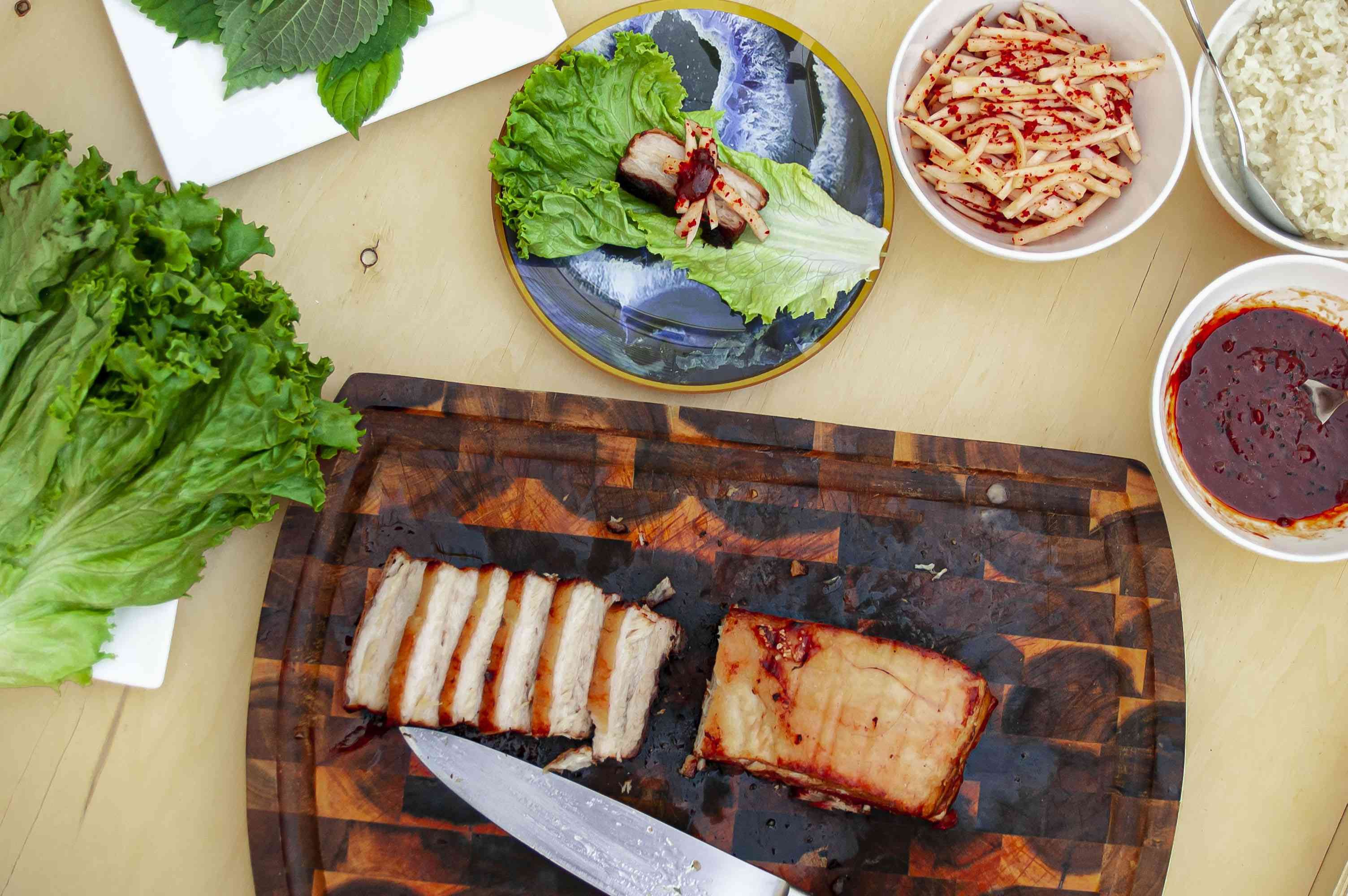 Korean pork belly lettuce wraps with pickled radish and sweet rice and savory sauce
