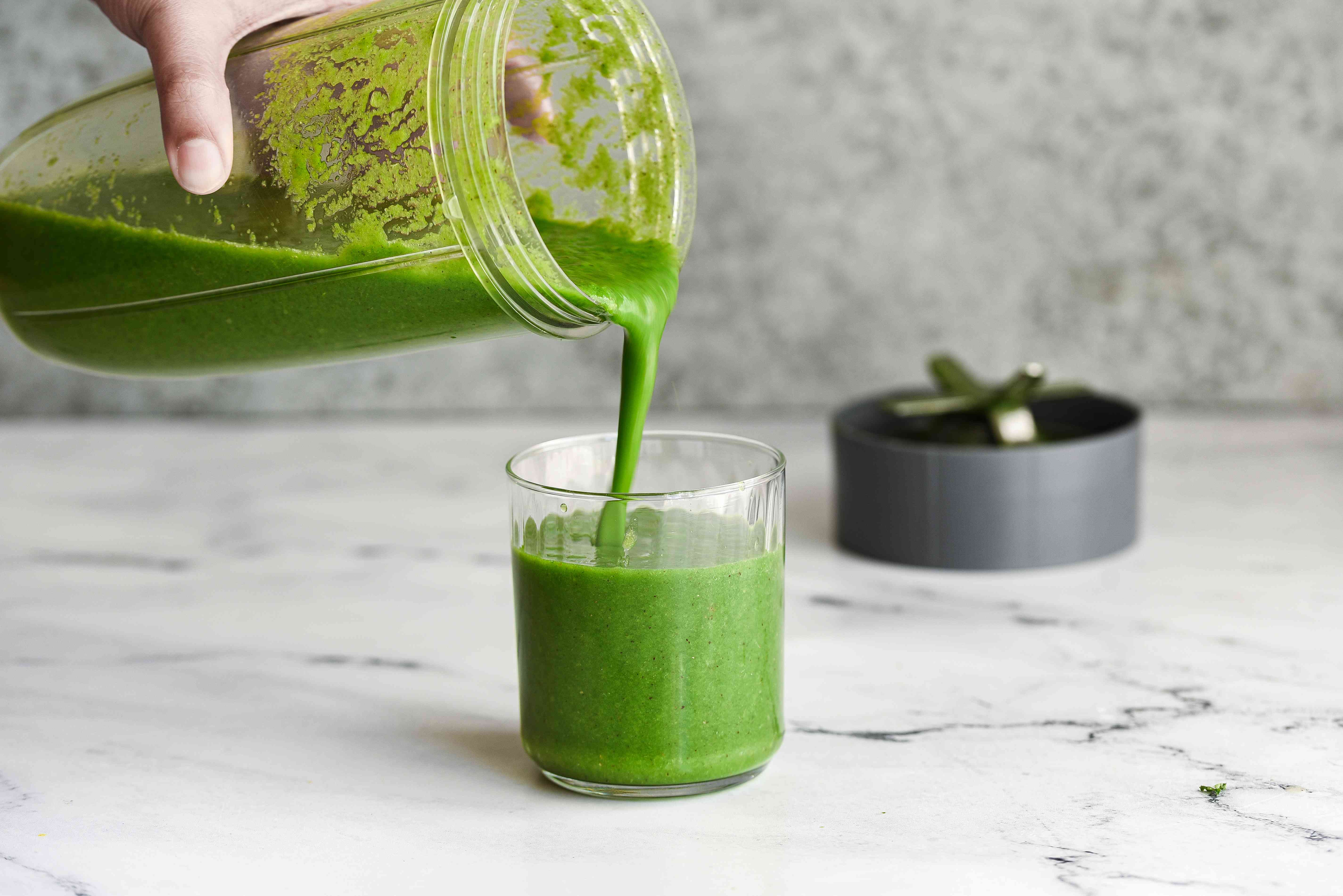 Apple Kiwi Superpower Green Smoothie poured into a glass