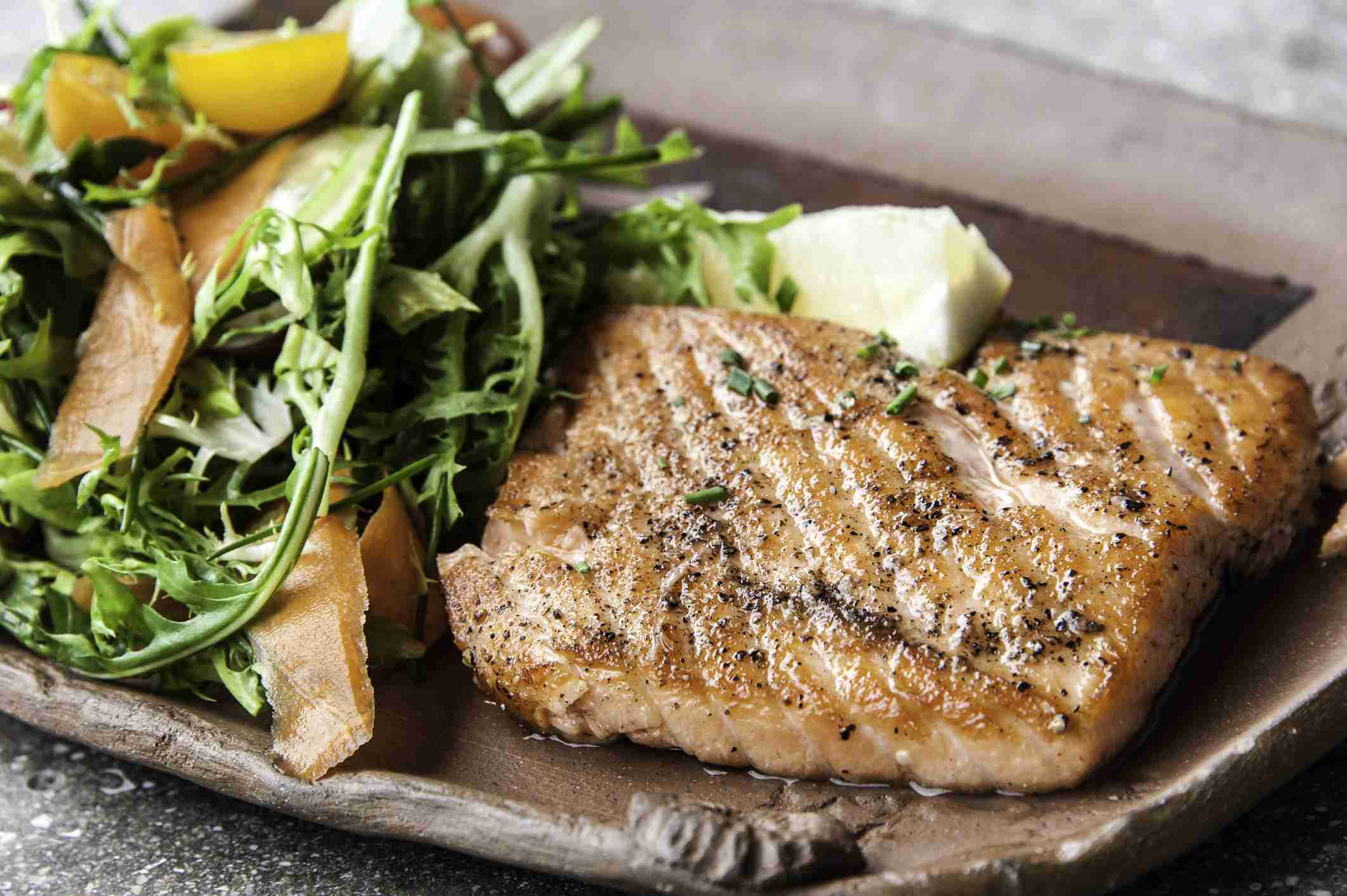 Grilled salmon and side salad