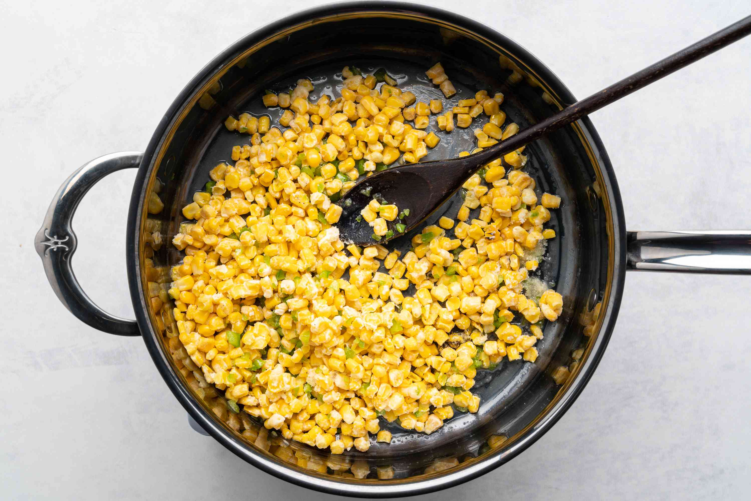 corn mixture cooking in a skillet