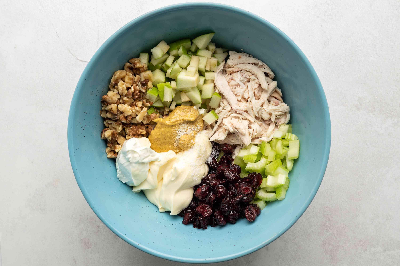 Combine the chicken, Granny Smith apples, celery, walnuts, dried cranberries, mayonnaise, yogurt, honey mustard, lemon juice, and salt in a medium bowl