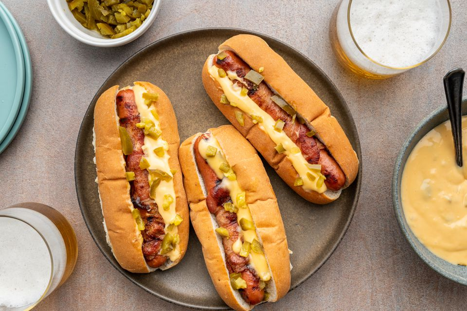 Bacon Wrapped Hot Dogs With Jalapeno Cheese Sauce