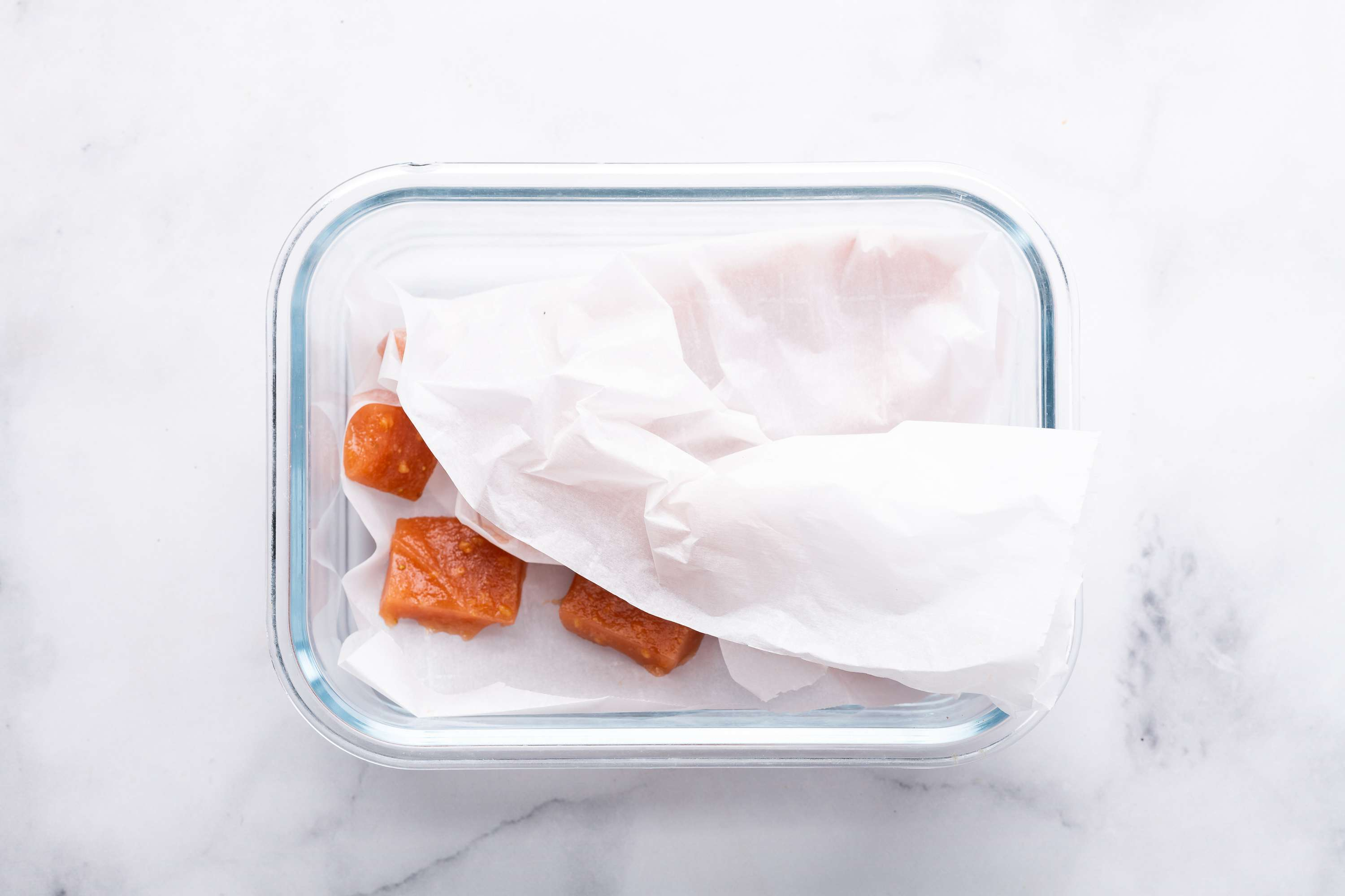 Indian Guava Cheese pieces in a glass container
