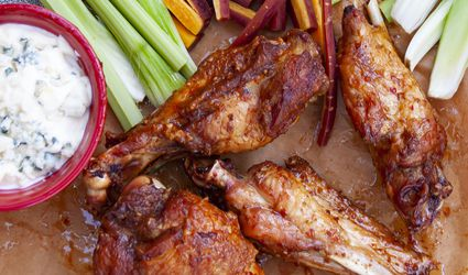 Deep fried turkey wings with buffalo style spicy sauce, blue cheese dressing and crudités
