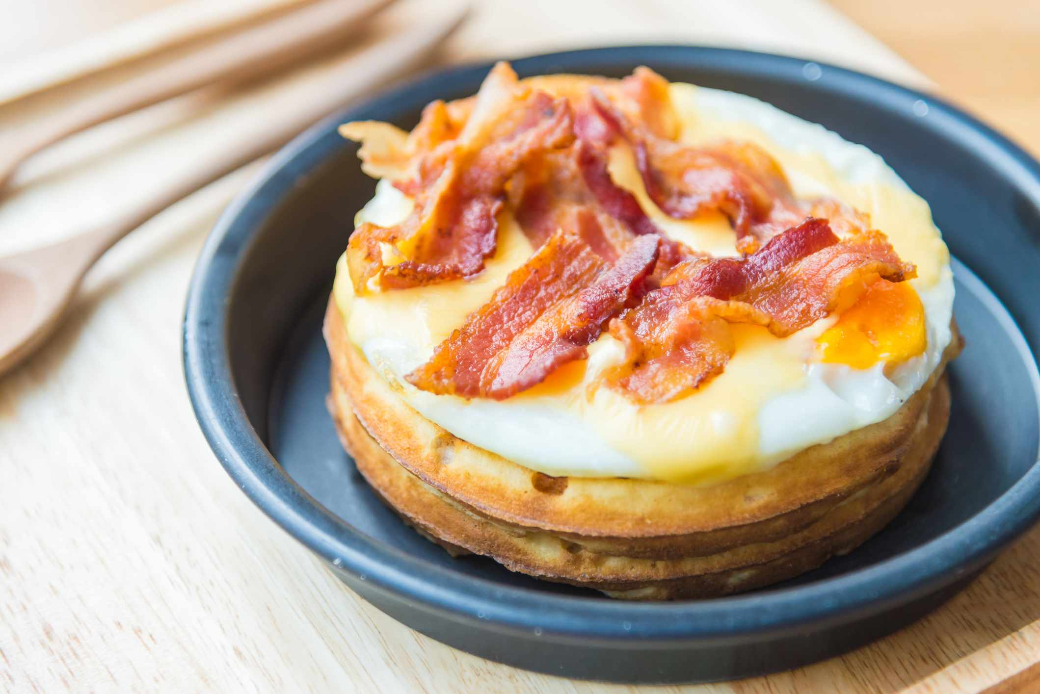 Bacon and eggs on waffle