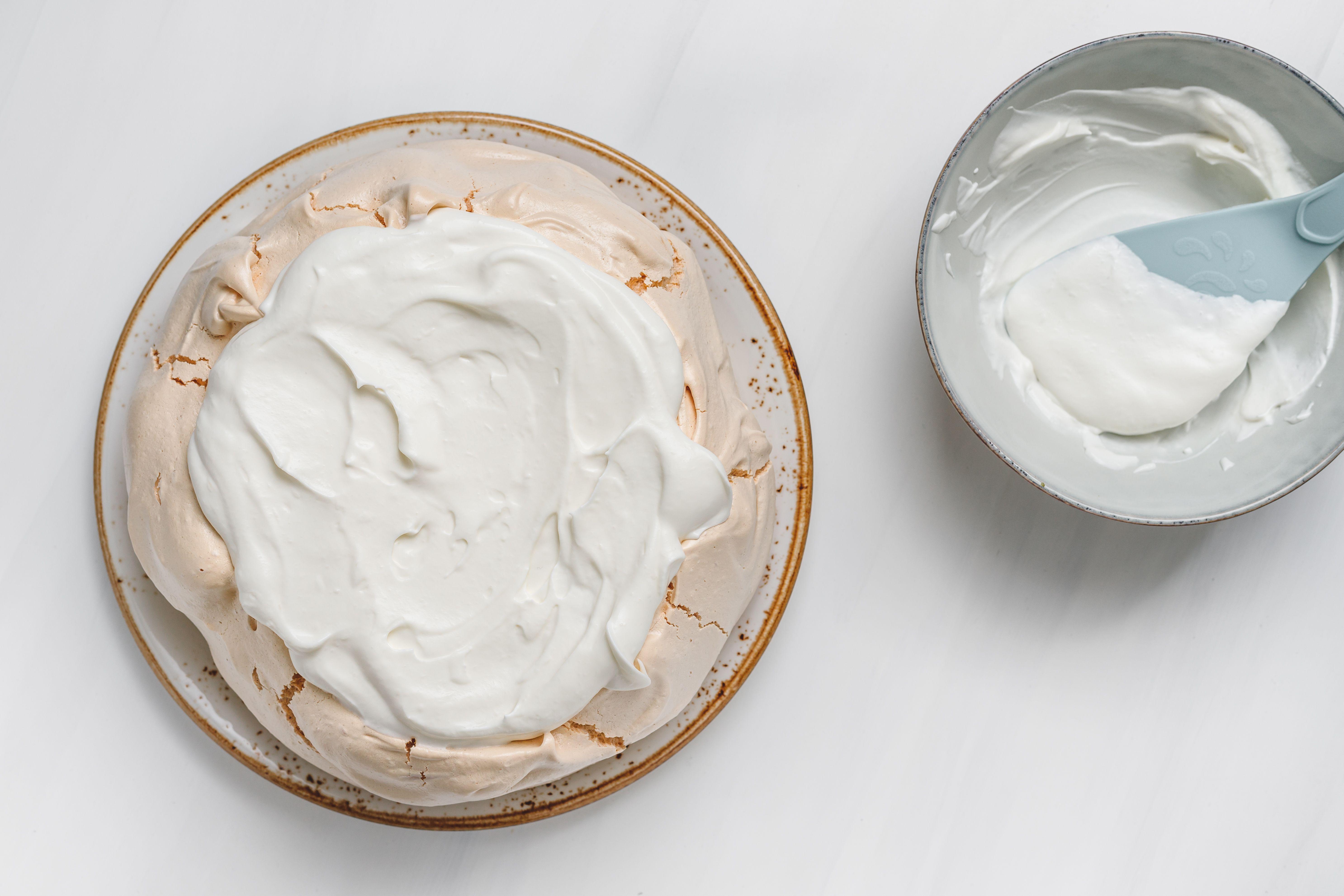 Whipped cream spread over meringue