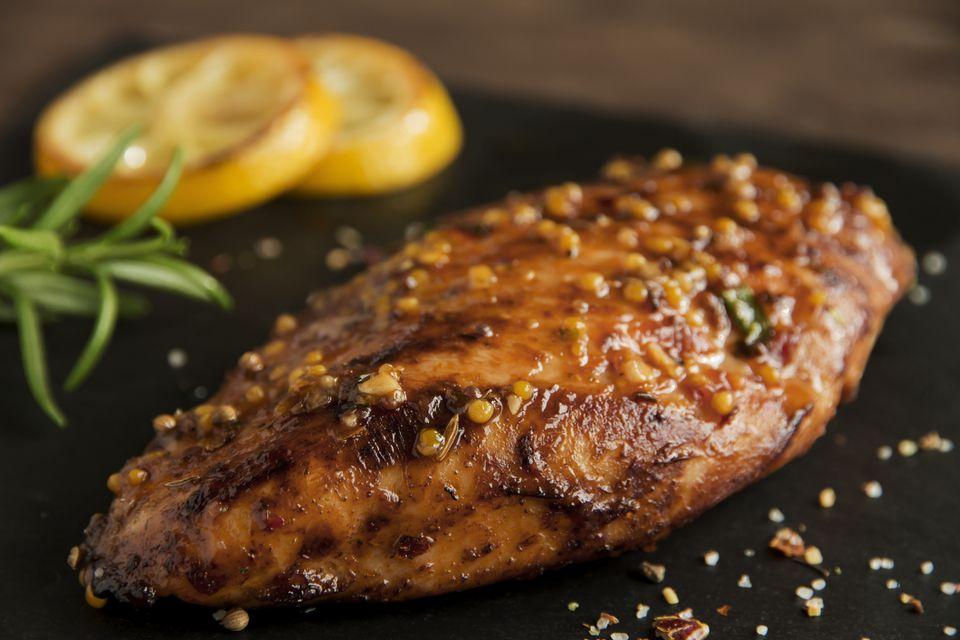 roasted chicken fillet breast with lemon tomato rosemary mustard seeds honey