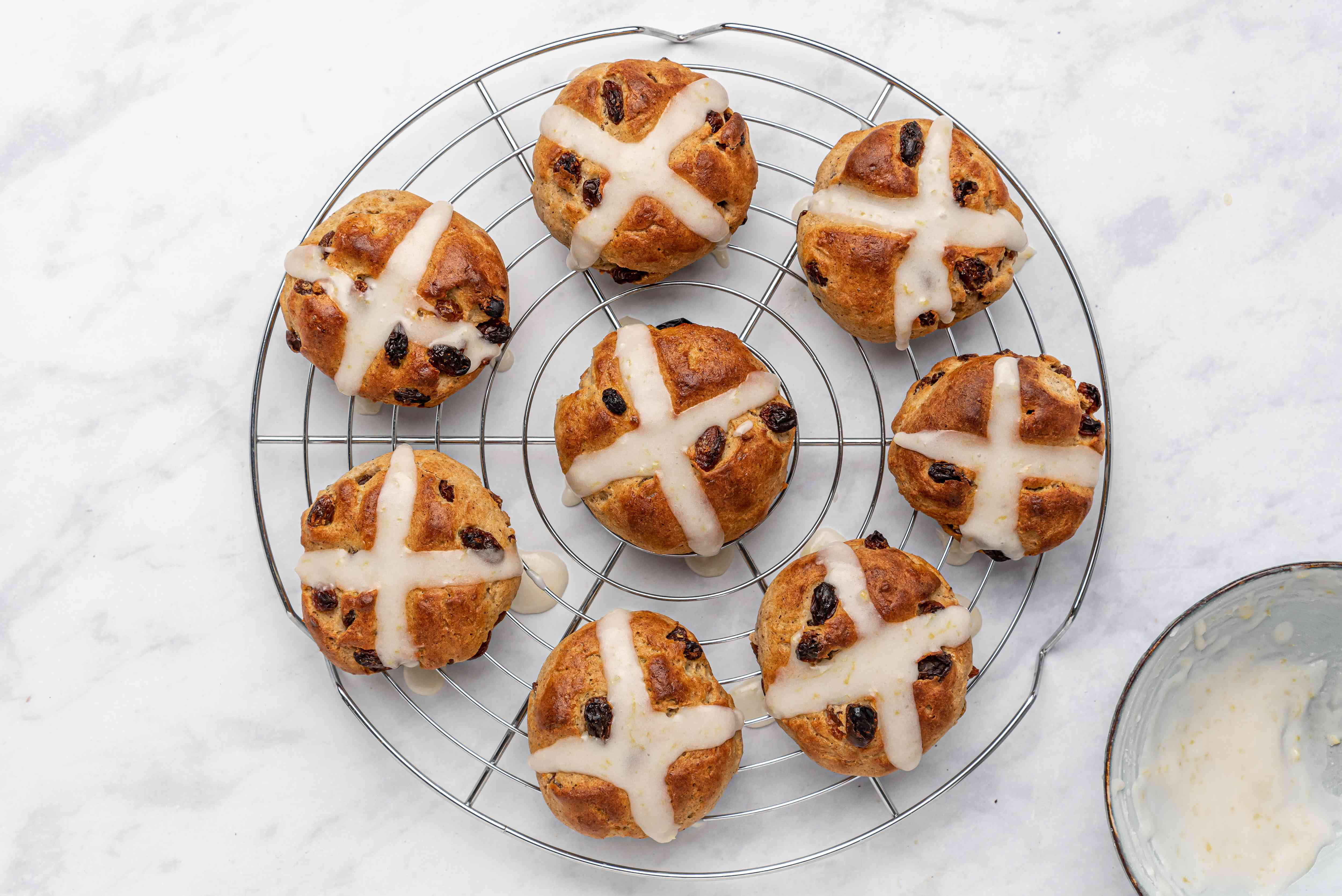 Gluten- and Dairy-Free Hot Cross Buns on a cooling rack
