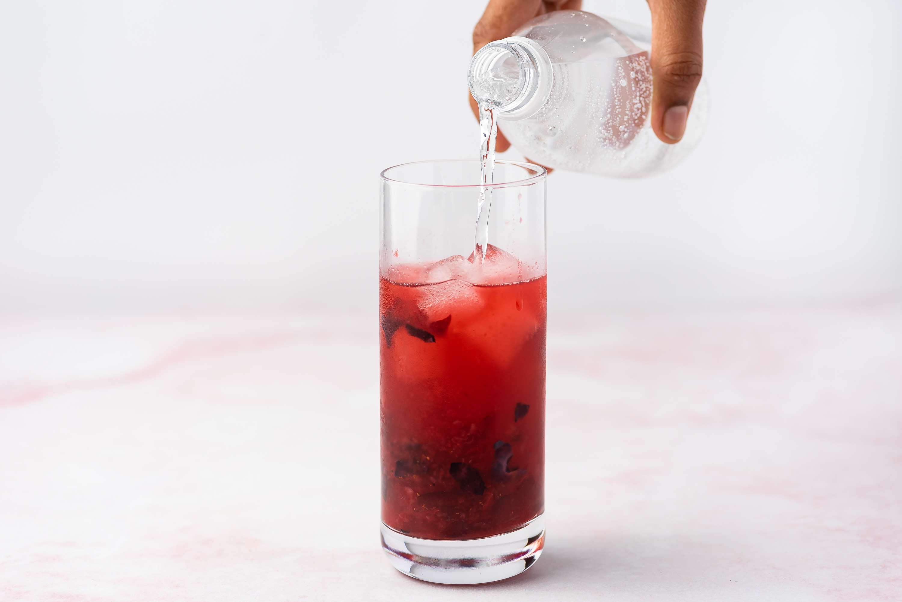 add club soda to the mixture in the glass