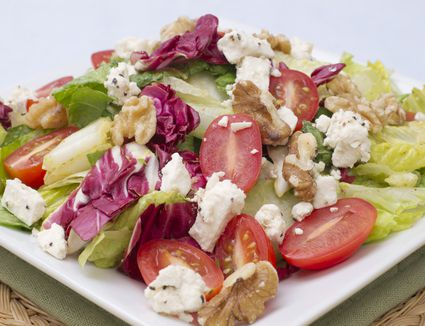 Healthy Tossed Lettuce Salad with Tomatoes, Cheese, and Nuts
