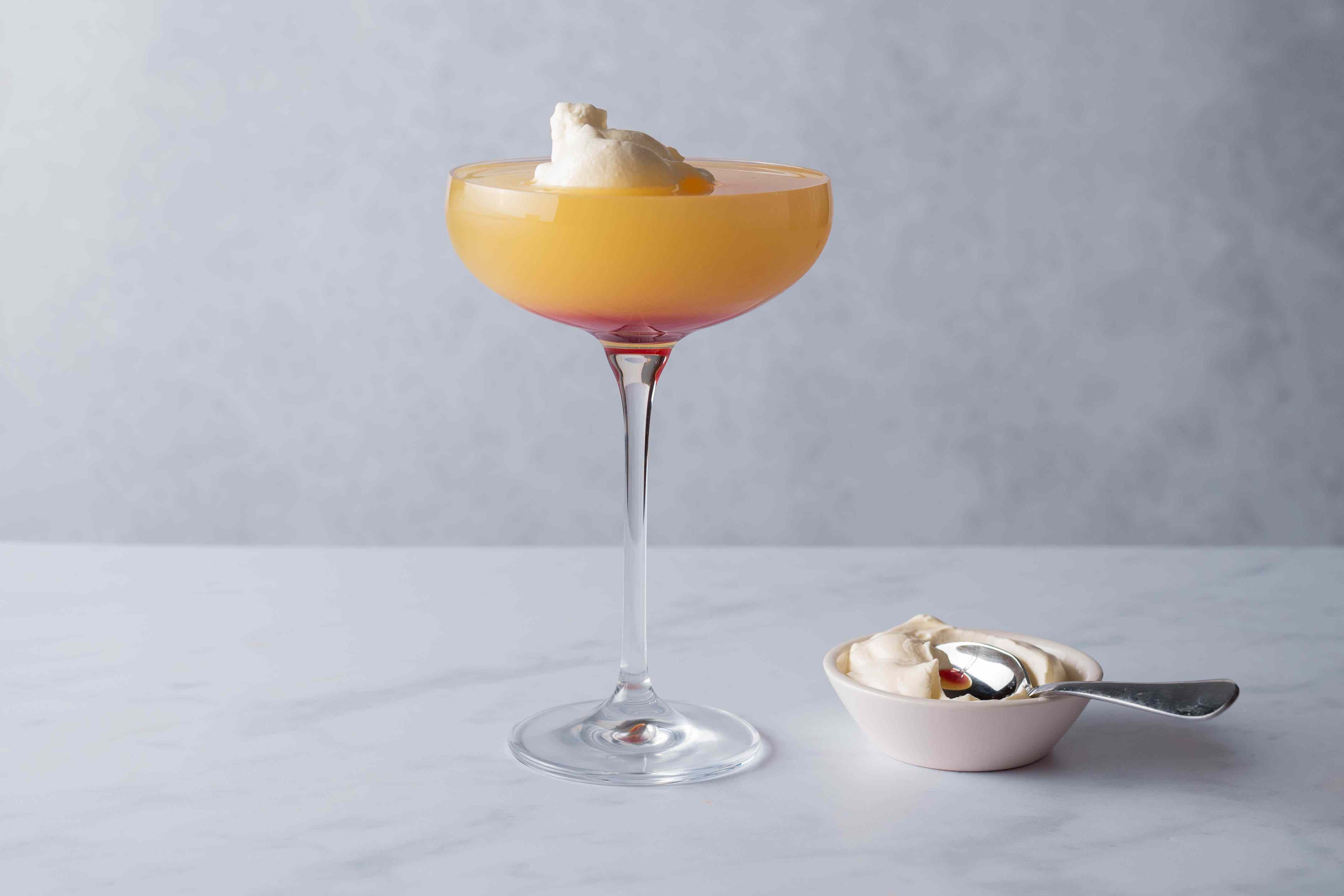 Whipped Sunset Cocktail, Garnished with whipped cream