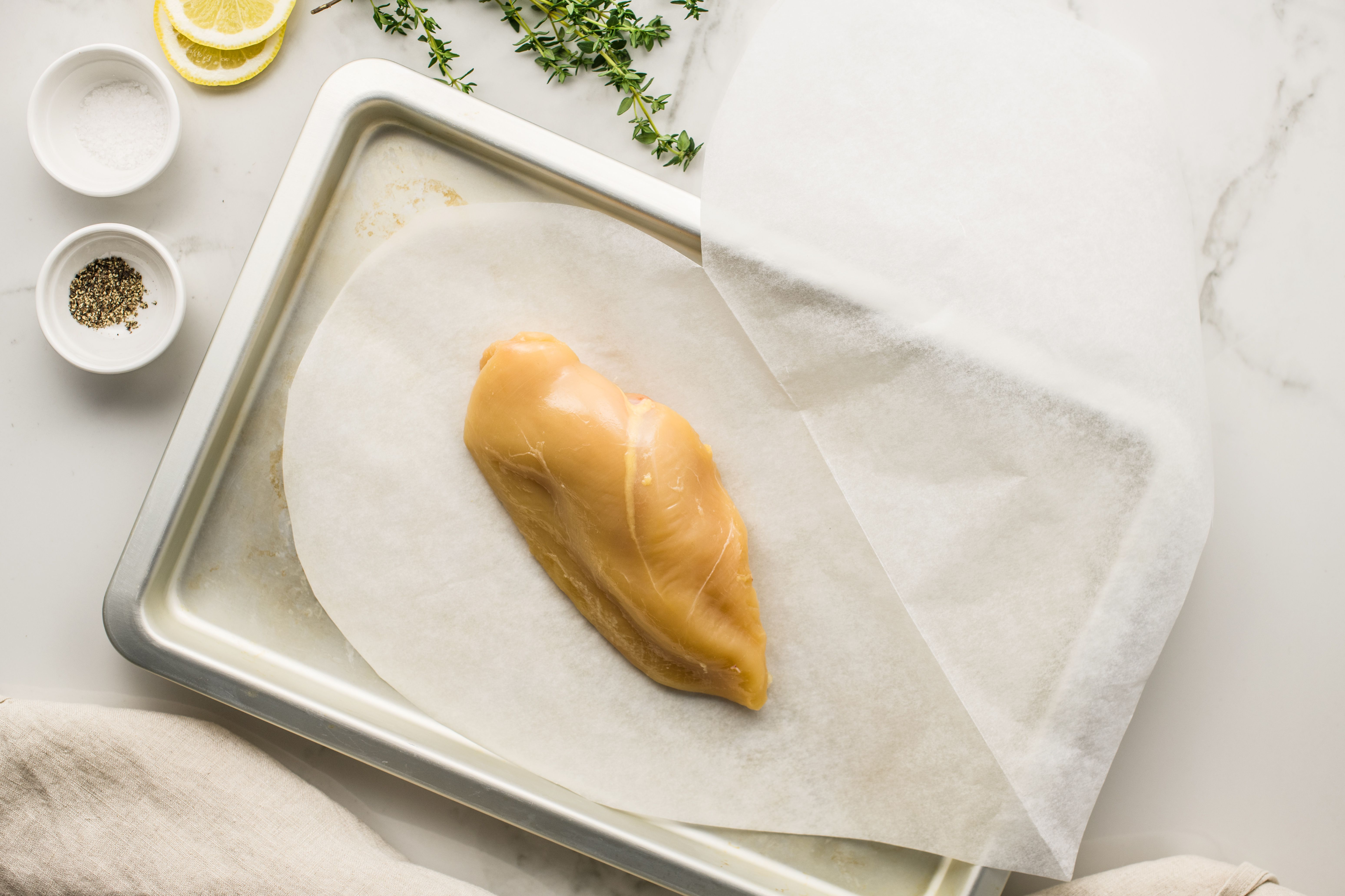 Place chicken breast in center of heart-shaped parchment paper