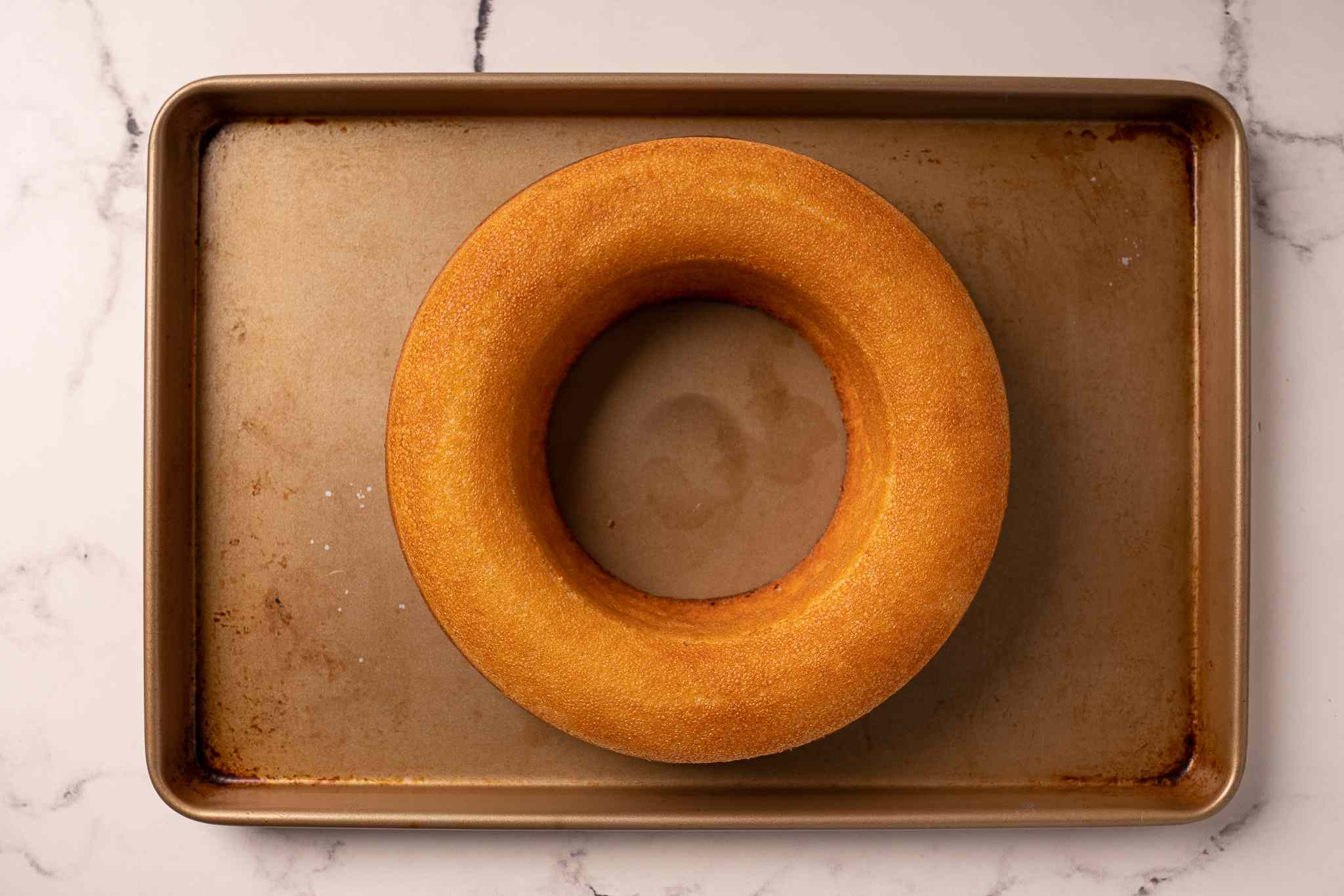 Baked savarin on a baking sheet