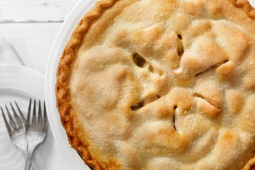 Six vent slits in the top crust of an apple pie