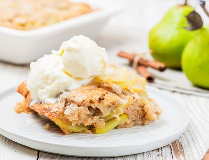 Pear cobbler topped with vanilla ice cream