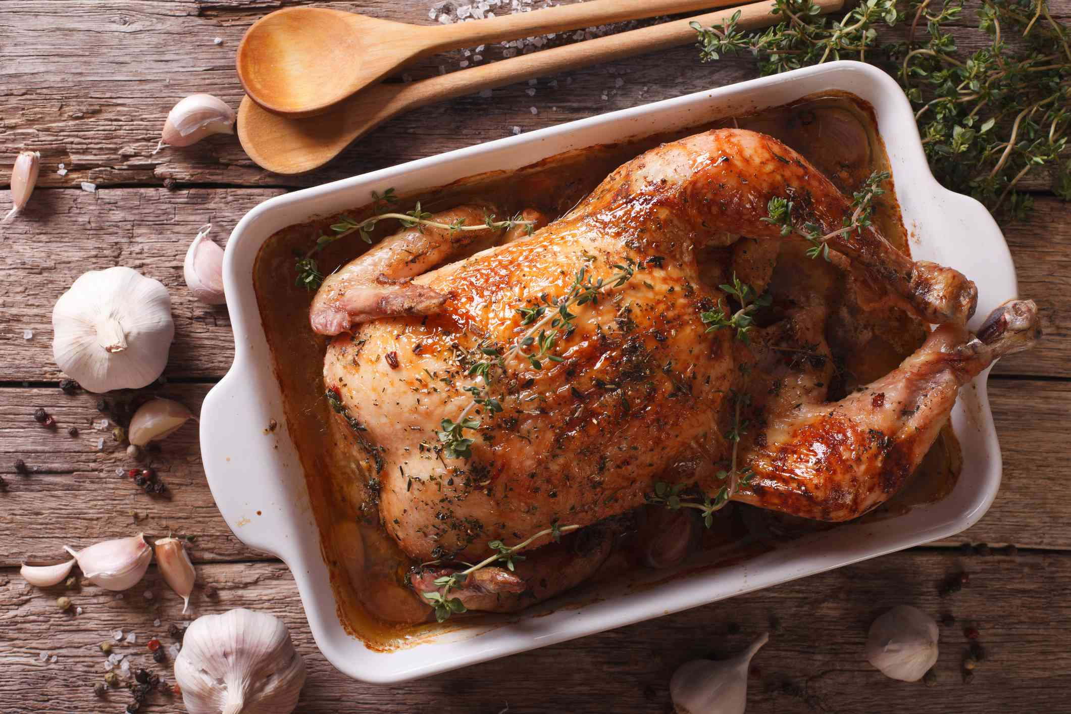 French cuisine: Chicken with forty cloves of garlic close-up. horizontal