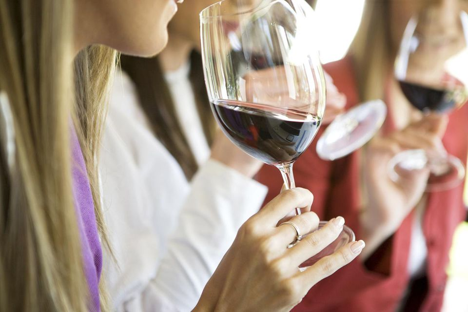 Women tasting wine with friends