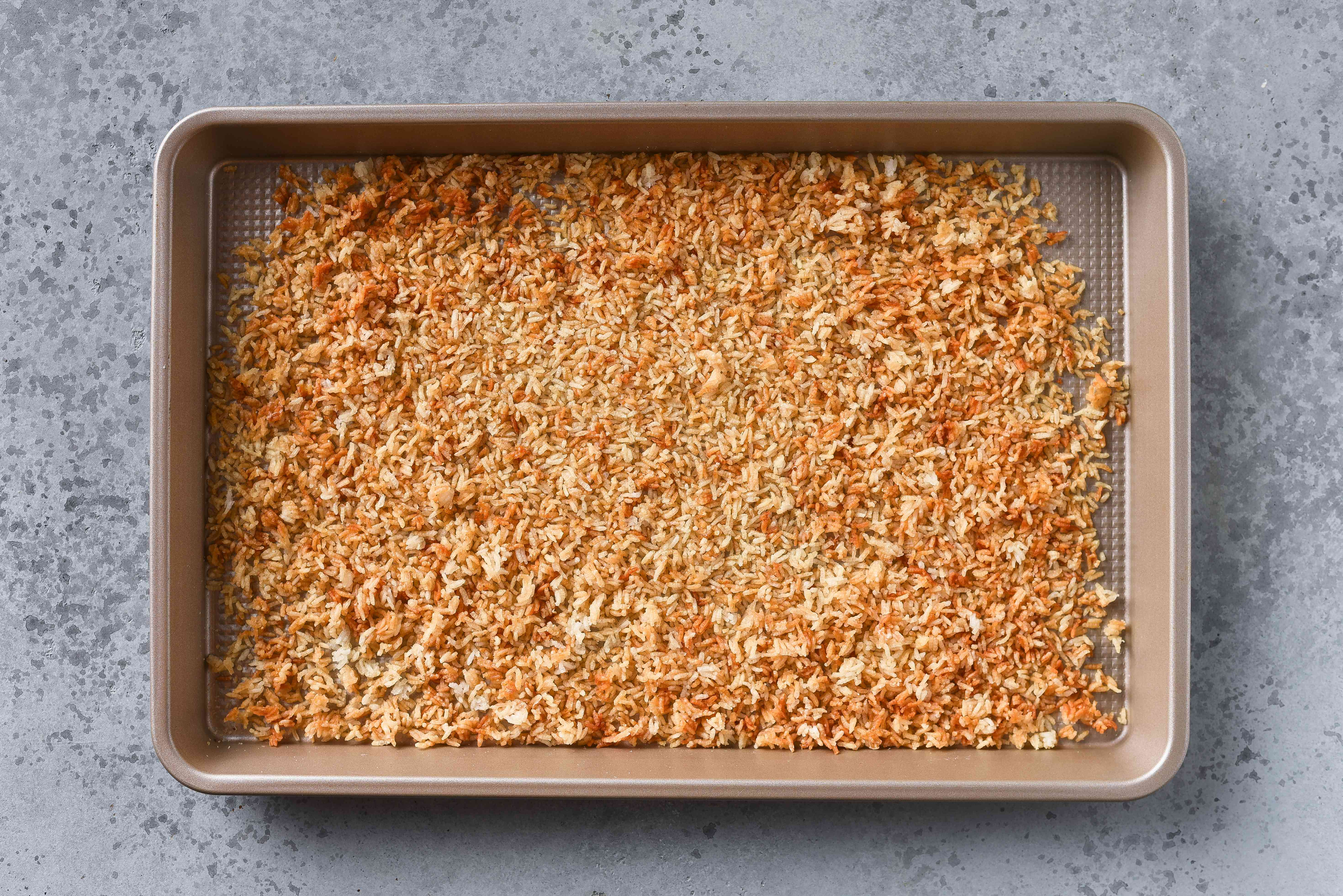 toasted rice on a baking sheet
